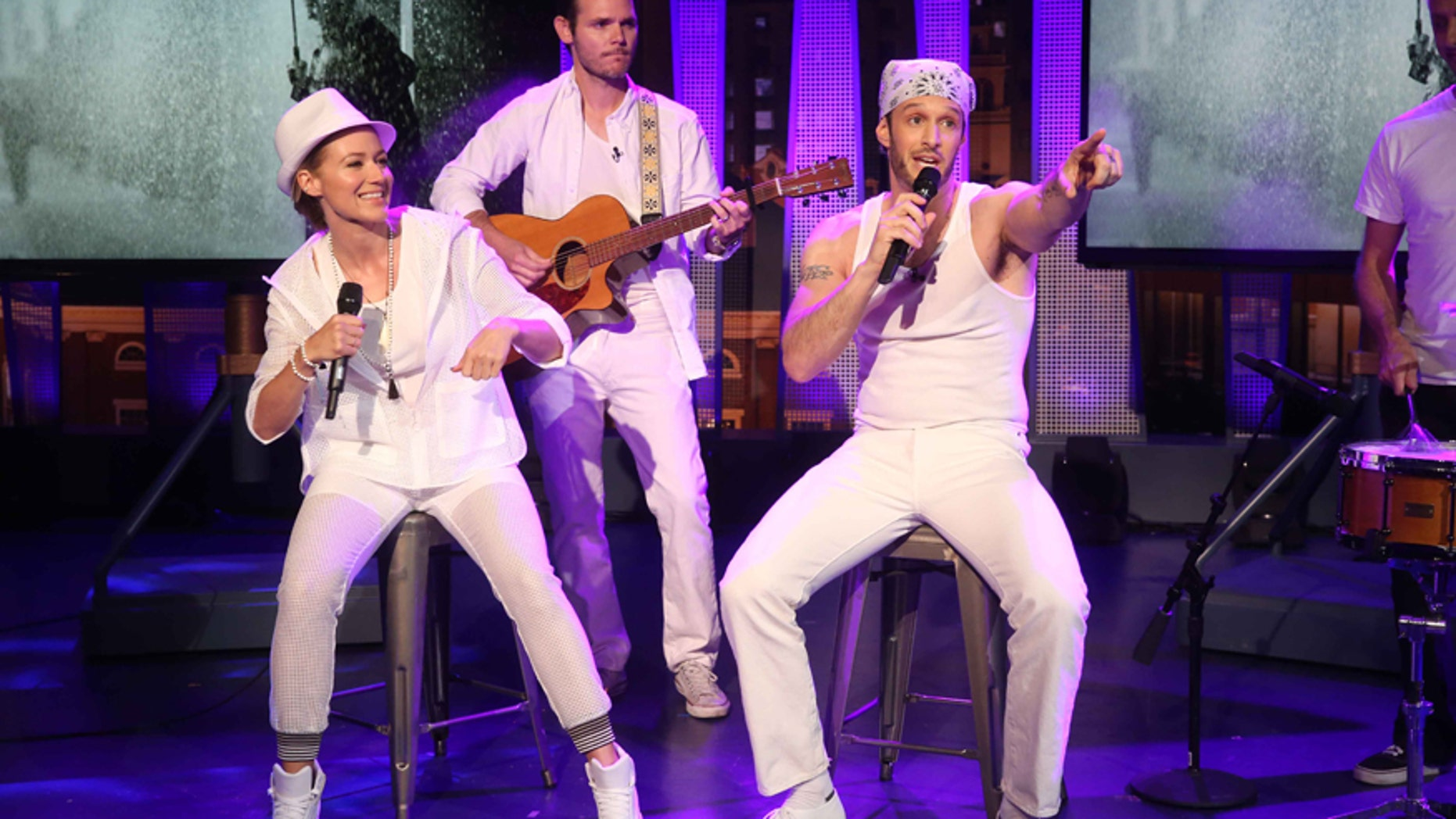 """Singer Jewel (left) performs with Josh Wolf on CMT's """"The Josh Wolf Show."""""""