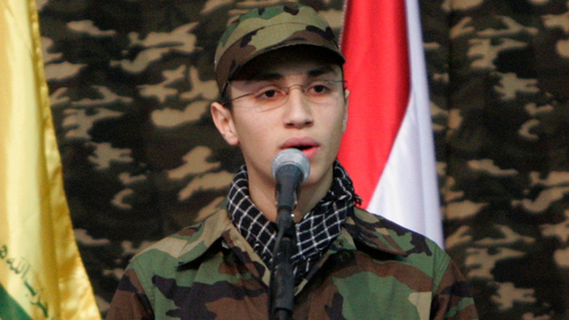 Feb. 22, 2008: Jihad Mughniyeh, the son of slain top Hezbollah commander Imad Mughniyeh, speaks during a rally to commemorate his father and two other leaders Abbas Musawi and Ragheb Harb, in the Shiite suburb of Beirut, Lebanon. A Hezbollah official said Sunday, Jan. 18, 2015, that an Israeli strike in the Syrian Golan Heights killed Jihad Mughniyeh and four other fighters from the Lebanese Shiite militant group.