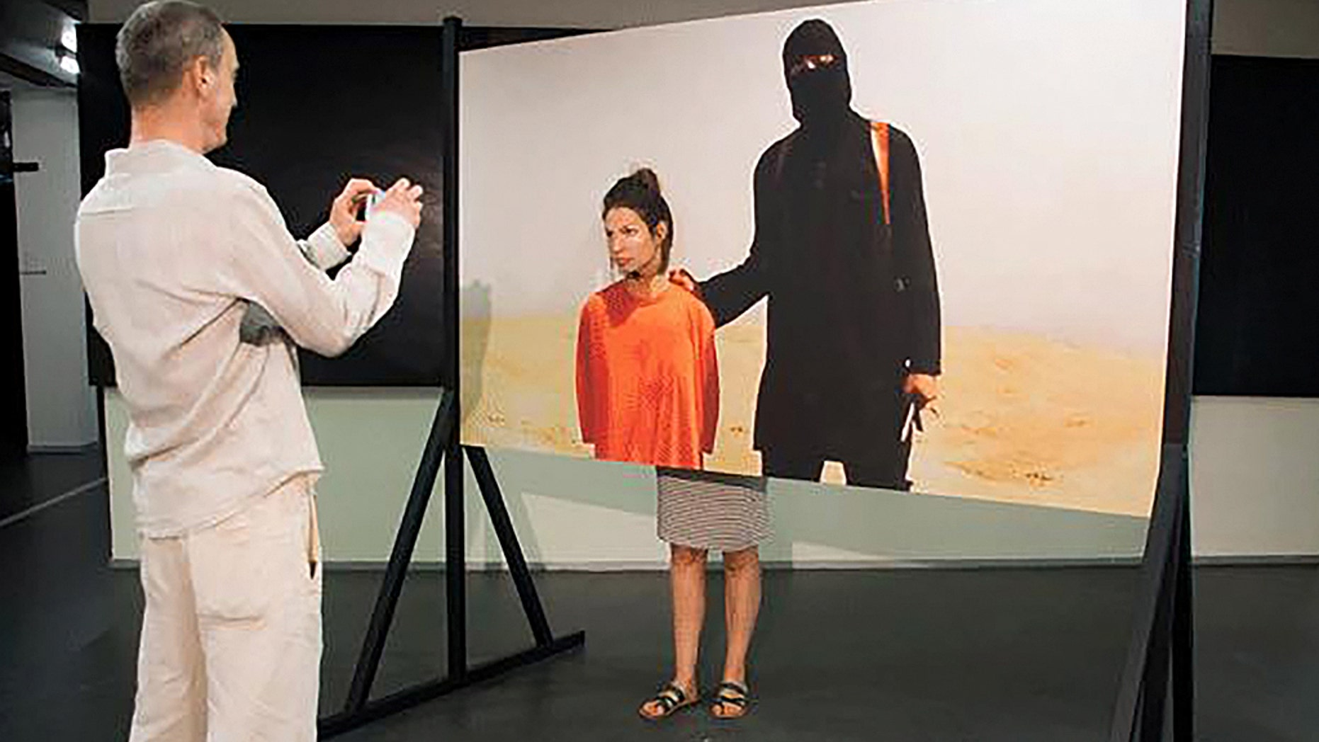 The ISIS artwork on show at the festival An art installation where visitors are encouraged to have a photo taken next to an Islamic State terrorist waiting to behead them has been blasted by politicians