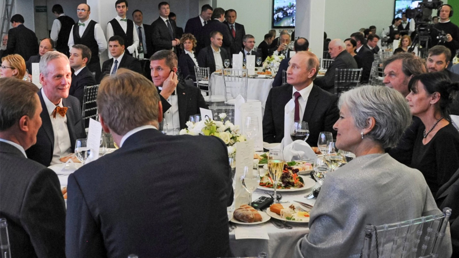 Russian President Vladimir Putin, center right, with retired U.S. Lt. Gen. Michael T. Flynn, center left, and former Green Party presidential candidate Jill Stein, front right, attend a 2015 dinner in Moscow.