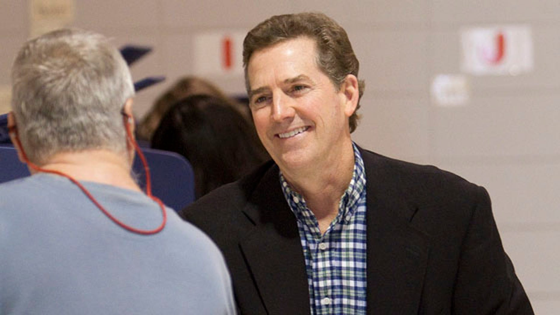 Nov. 2: Incumbent U.S. Sen. Jim DeMint, right, waits to cast his vote at Mitchell Road Elementary School in Greenville, S.C. DeMint won an easy election for a second term.