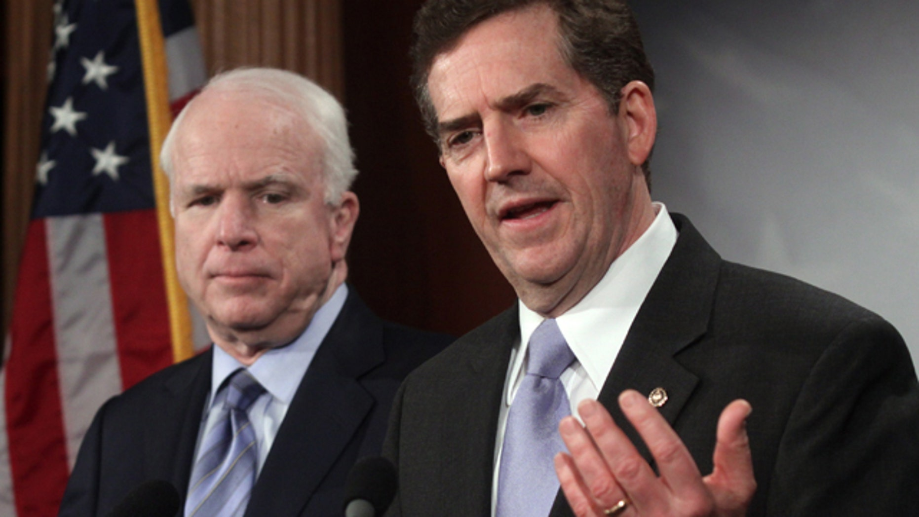 Feb. 4, 2010: Sen. Jim DeMint, R-S.C., right, attends a news conference with John McCain on Capitol Hill in Washington.