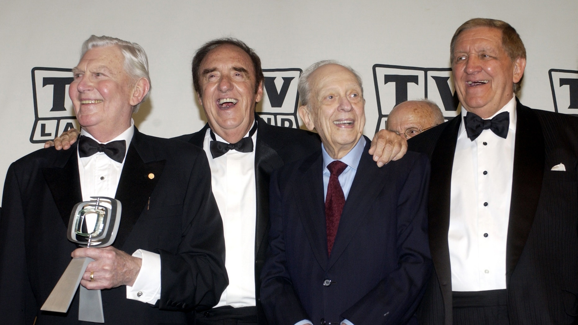 """Andy Griffith, Jim Nabors, Don Knotts and George Lindsey, cast members in """"The Andy Griffith Show,"""" pose backstage after accepting the Legend Award for their series during a taping of the second annual TV Land Awards in Hollywood March 7, 2004."""