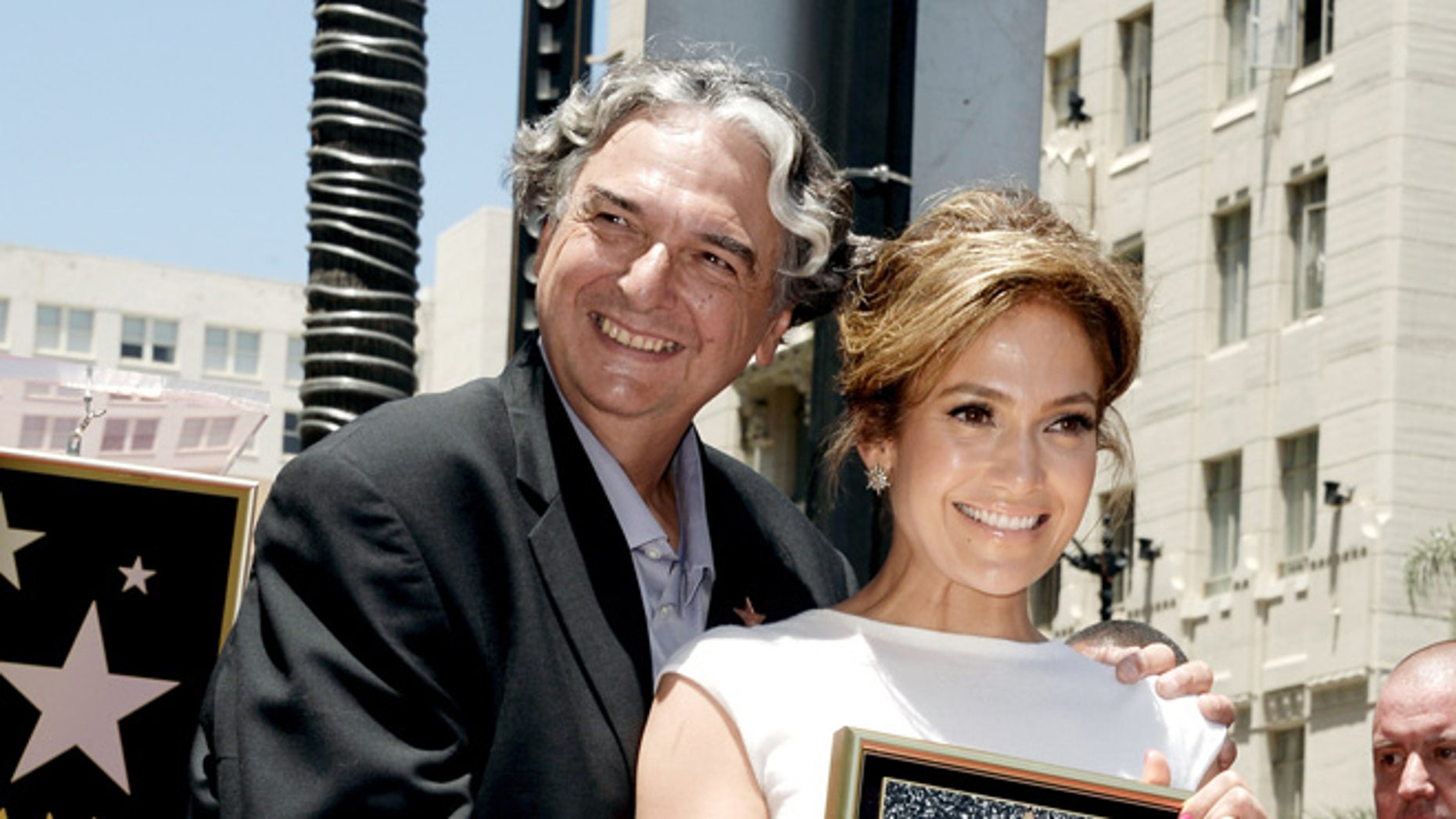 Jennifer Lopez, with director Gregory Nava, honored on the Hollywood Walk of Fame on June 20, 2013 in Los Angeles.