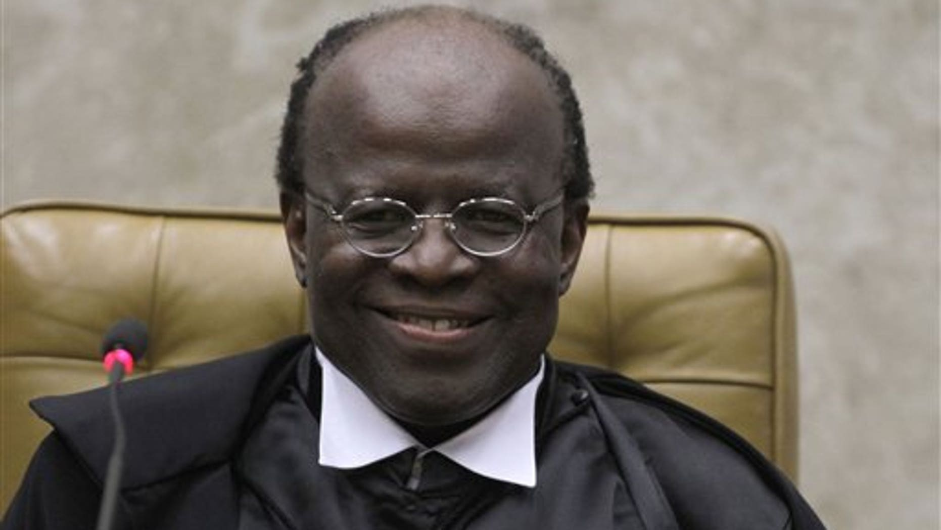 Joaquim Barbosa smiles during his inauguration ceremony at the Supreme Court in Brasilia, Brazil.