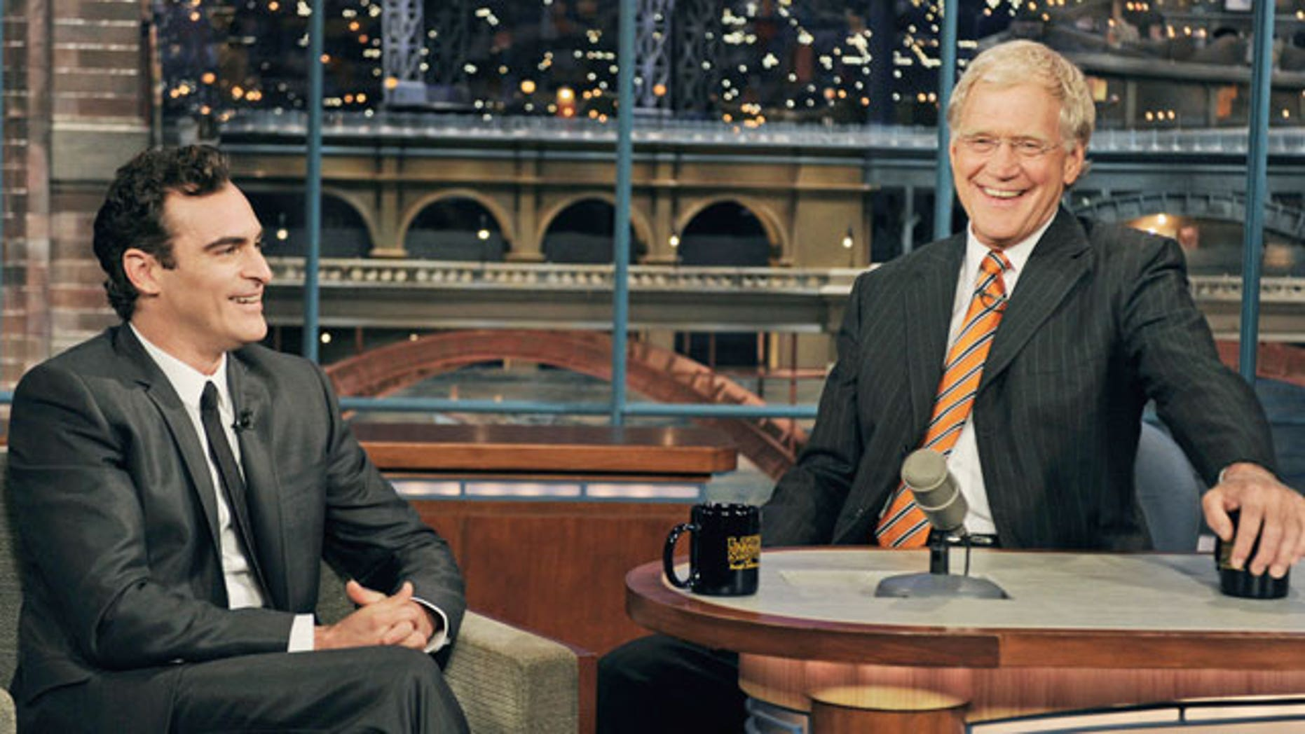 """Sept. 22: In this photo released by CBS, actor Joaquin Phoenix, left, gestures to host David Letterman on the set of the """"Late Show with David Letterman."""""""