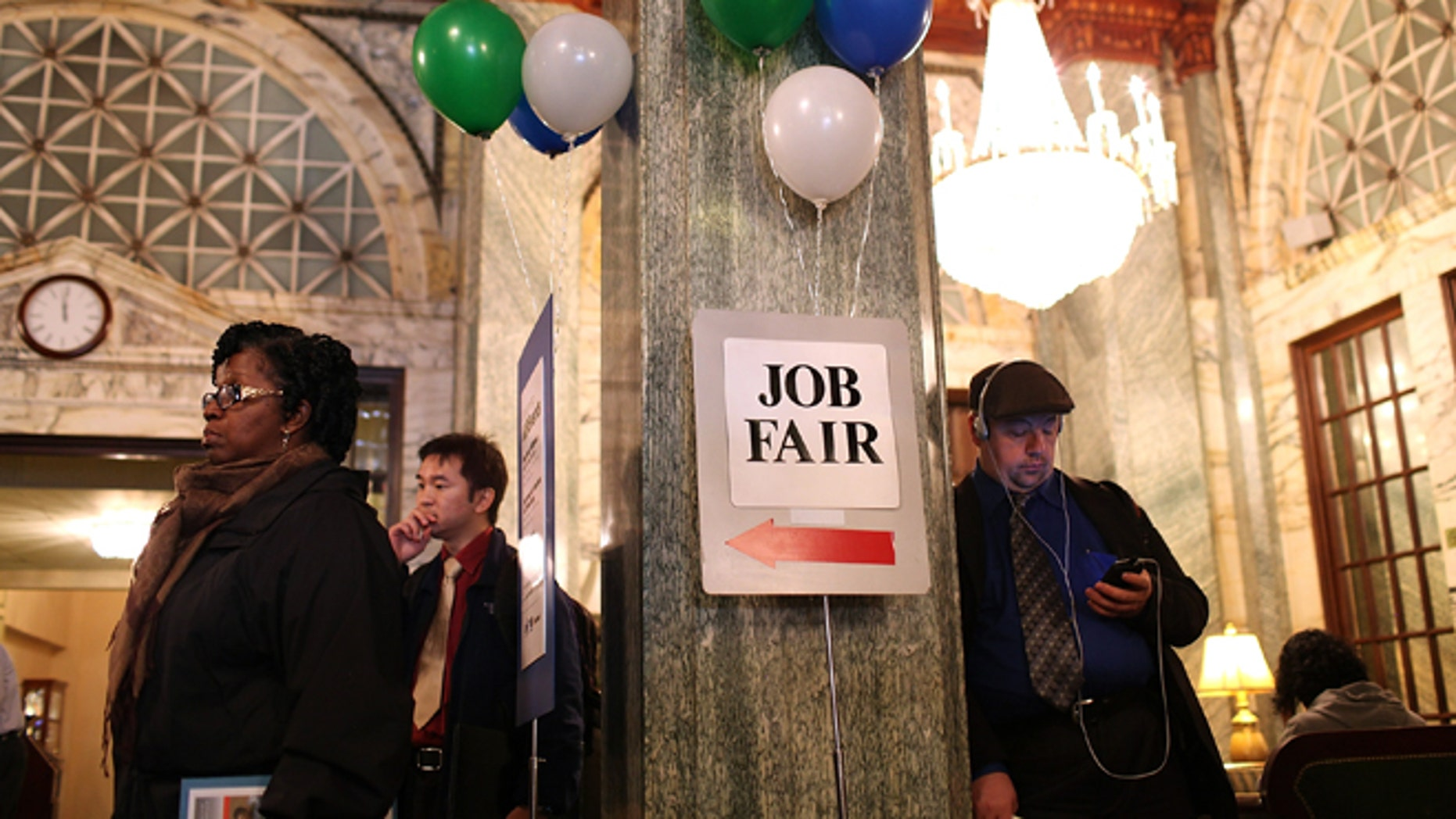 SAN FRANCISCO, CA - NOVEMBER 09:  Job seekers wait in line to enter the San Francisco Hire Event job fair on November 9, 2011 in San Francisco, California.  The national unemployment rate dipped this past month to 9 percent in October after employers added 80,000 jobs.  (Photo by Justin Sullivan/Getty Images)