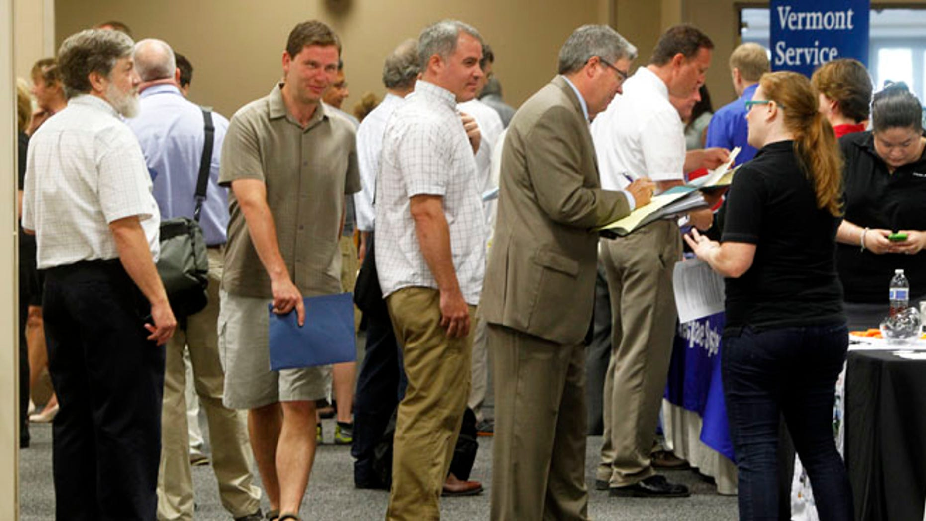 People line up at the job fair  in South Burlington, Vt.  A disproportionate number of the added jobs were part-time or low-paying, or both. Part-time work accounted for more than 65 percent of the positions employers added in July.