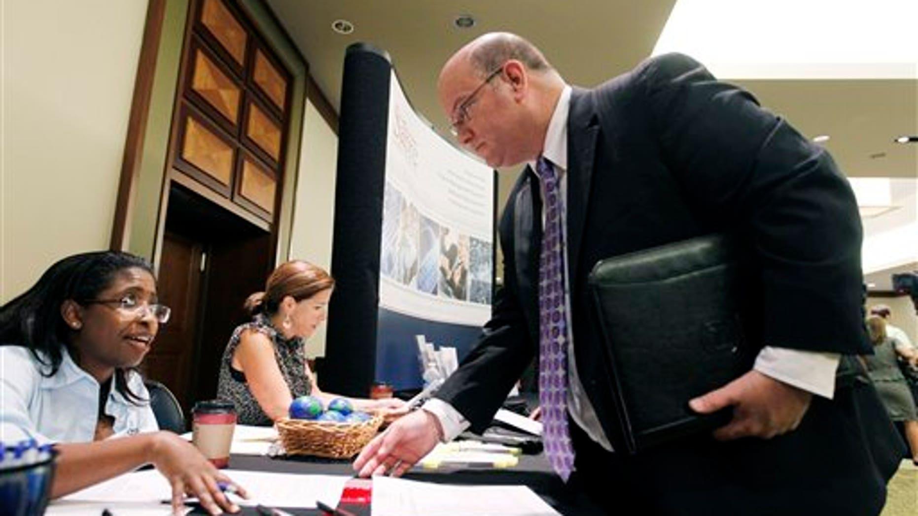 August 4: Job seeker during a Career Job Fair in Arlington, Va.