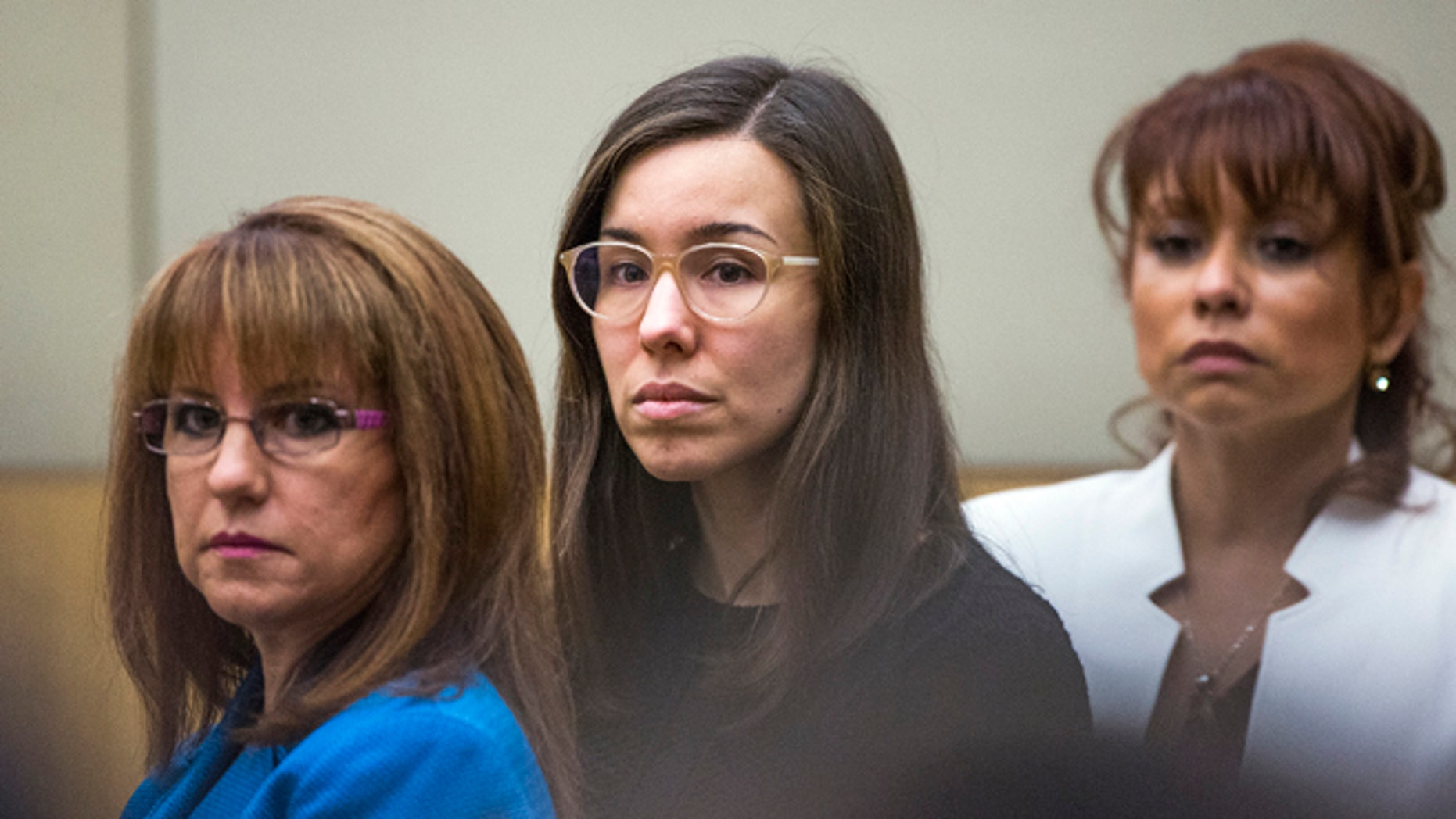 FILE - Convicted murderer Jodi Arias, center, watches the jury enter the courtroom before hearing their verdict in this March 5, 2015 file photo taken in Maricopa County Superior Court in Phoenix. A court document released Tuesday March 10, 2015 by the judge in the case reveals the behind-the-scenes wrangling in the jury room as Arias' fate hung in the balance. (AP Photo/The Arizona Republic, Tom Tingle, Pool, File)