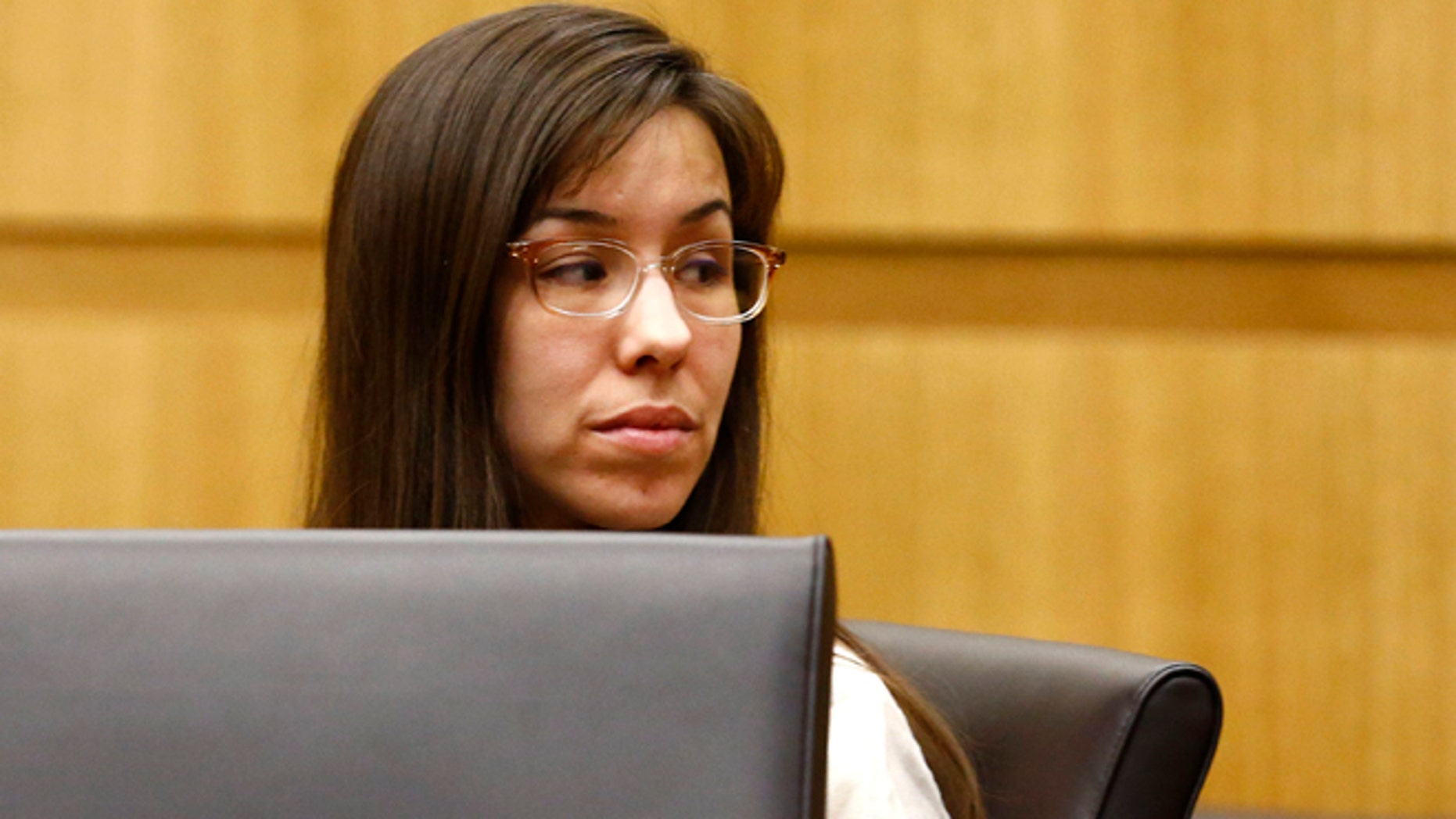 May 20, 2013: Jodi Arias looks at her family during the penalty phase of her murder trial at Maricopa County Superior Court in Phoenix, Ariz. (The Arizona Republic, Rob Schumacher, Pool)