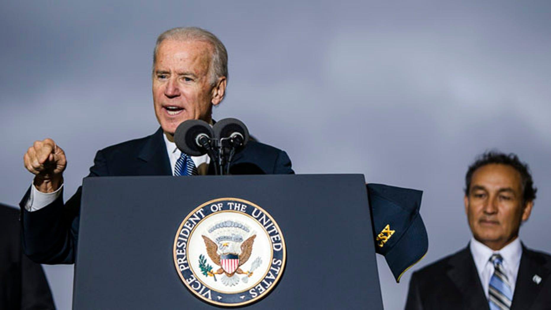 Vice President Joe Biden addresses an audience, Wednesday, Nov. 6, 2013, at the CSX Northwest Ohio Intermodal Terminal in North Baltimore, Ohio.
