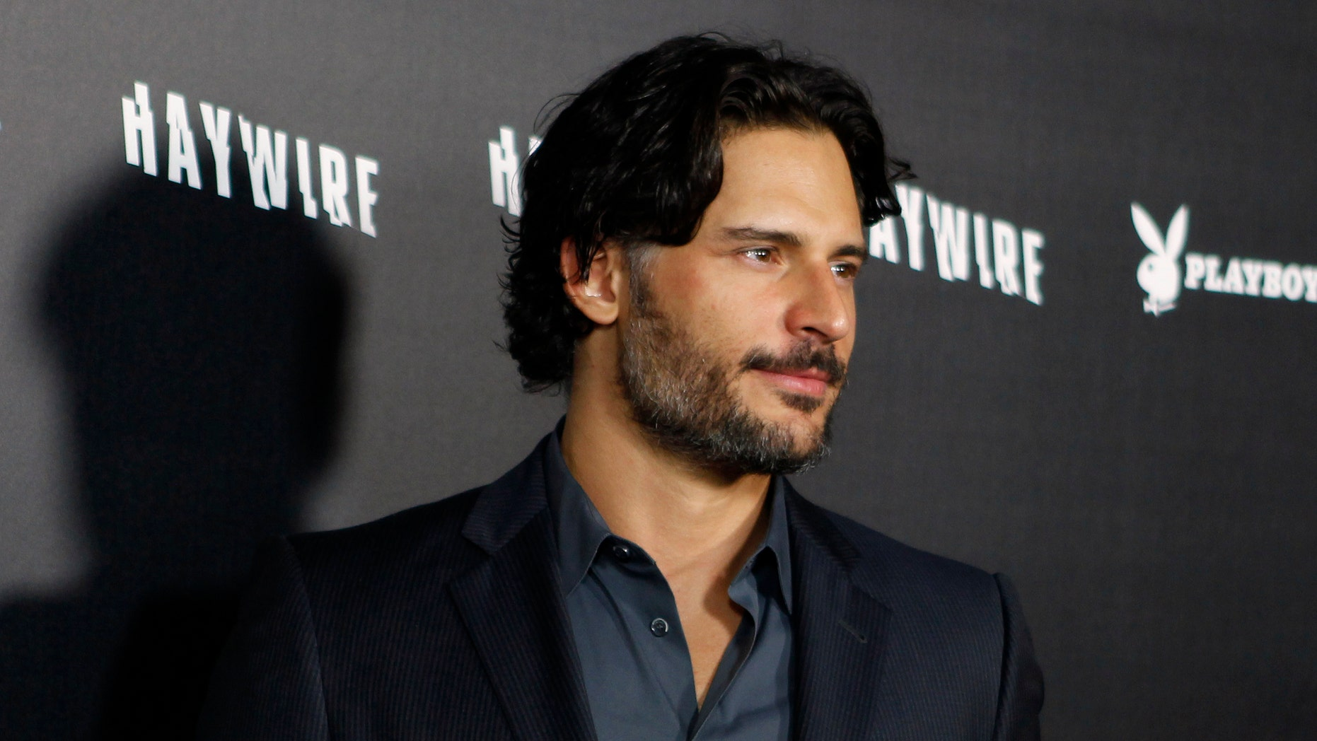 "Actor Joe Manganiello arrives at the premiere of director Steven Soderbergh's new film ""Haywire"" in Hollywood, California January 5, 2012. Manganiello stars in Soderbergh's upcoming film about male strippers titled ""Magic Mike"". REUTERS/Fred Prouser  (UNITED STATES - Tags: ENTERTAINMENT HEADSHOT) - RTR2VXY4"