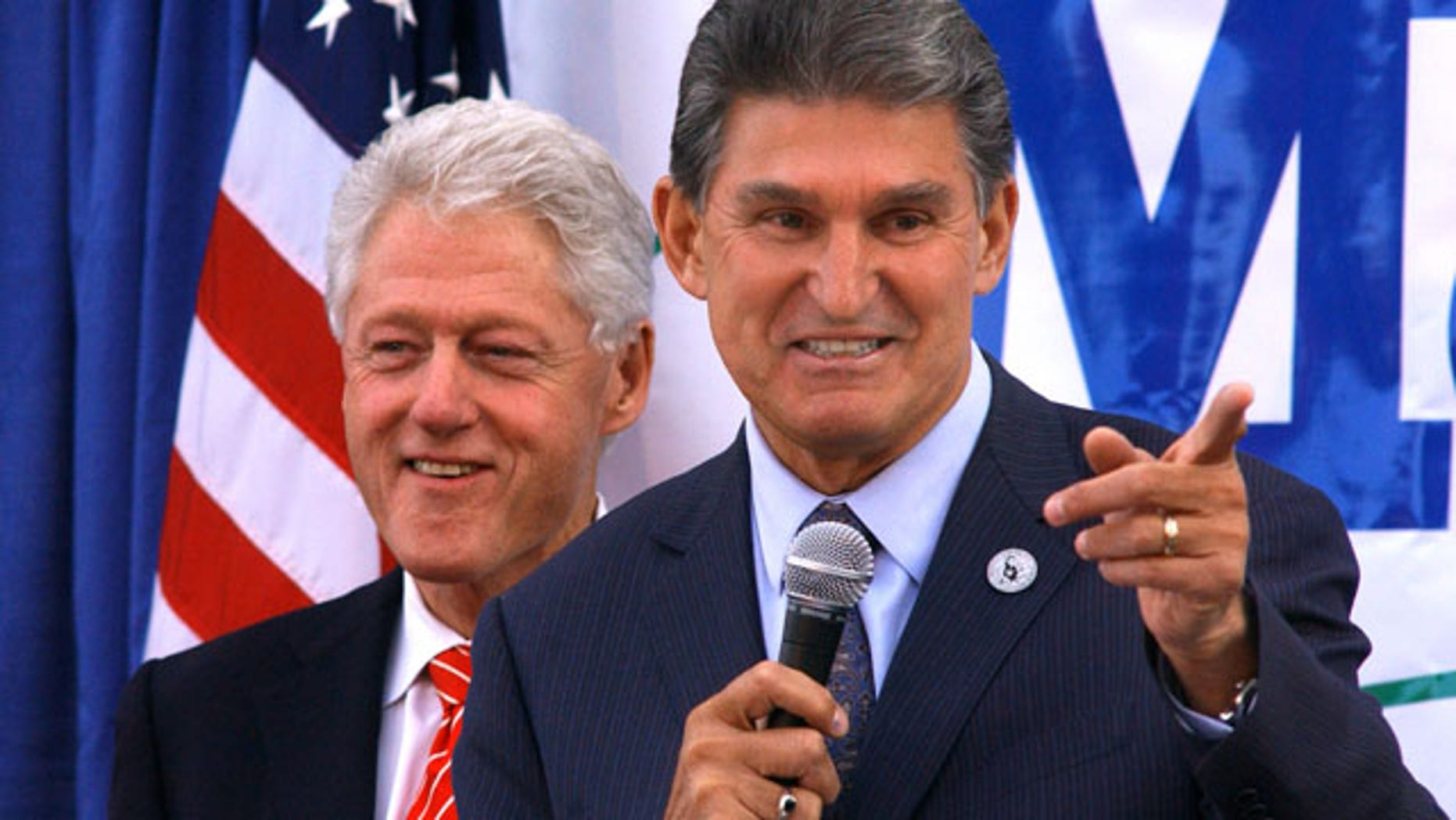Nov. 1: Former president Bill Clinton smiles as W.Va. Governor Joe Manchin campaigns at Tamarack in Beckley, W.Va.