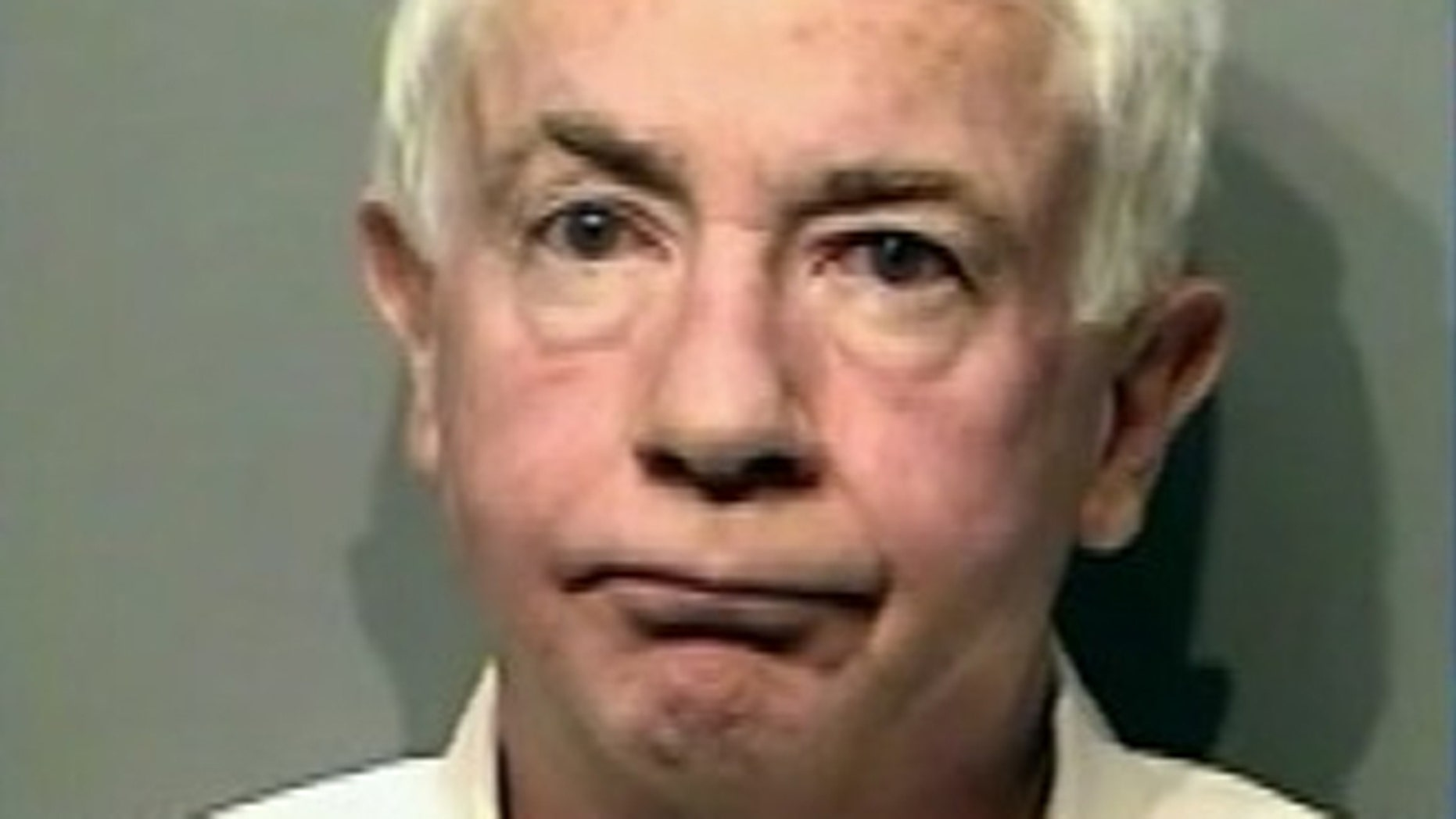 Joe Ricky Hundley, 60, is accused of slapping a 2-year-old boy during a flight from Minneapolis to Atlanta.
