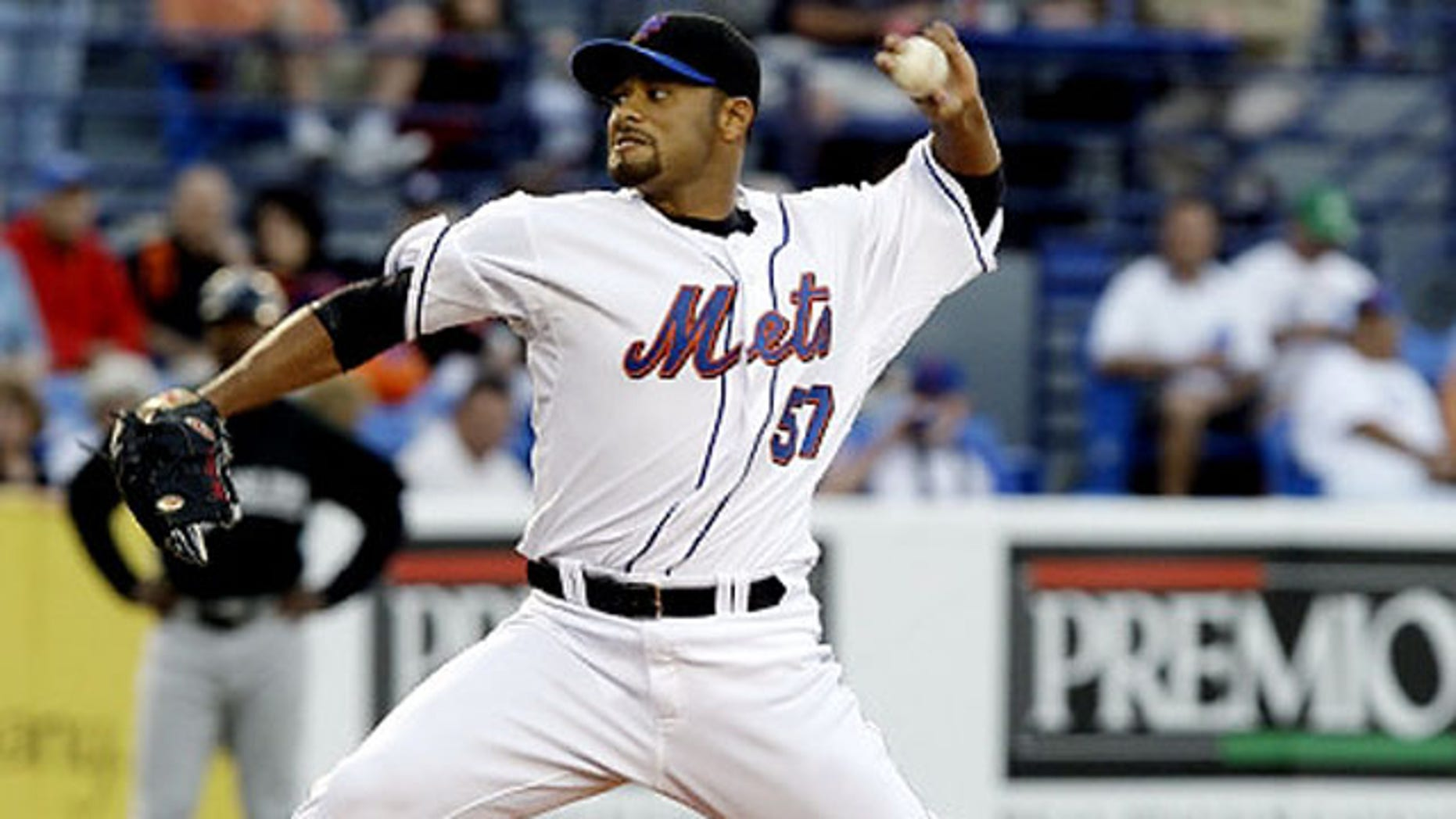March 12, 2009: New York Mets starting pitcher Johan Santana, from Venezuela, throws during a spring training baseball game against the Florida Marlins in Port St. Lucie, Fla.