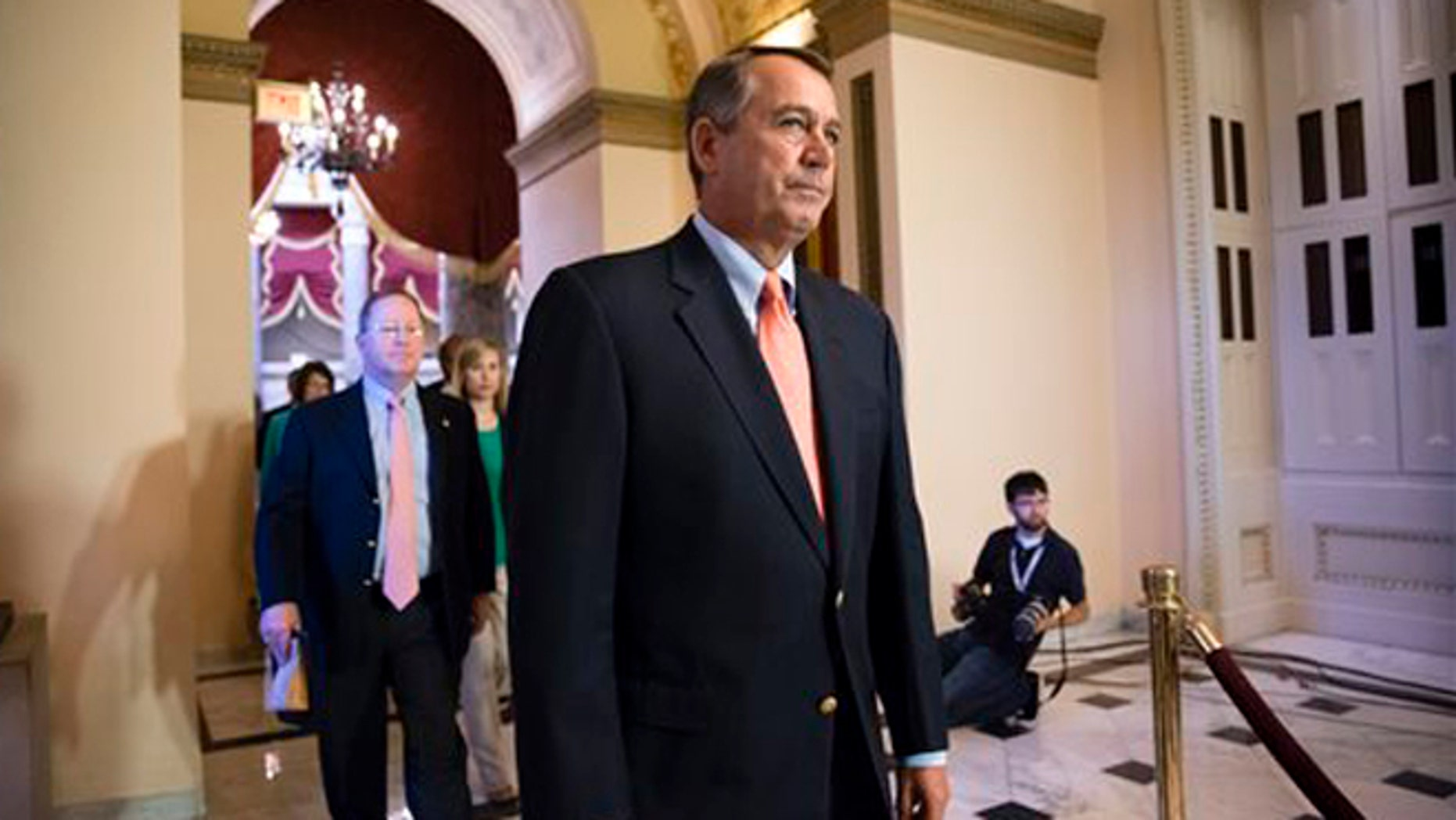 FILE: Oct. 5, 2013: House Speaker John Boehner walks to the chamber as lawmakers vote to pay furloughed federal workers, at the Capitol in Washington, D.C.