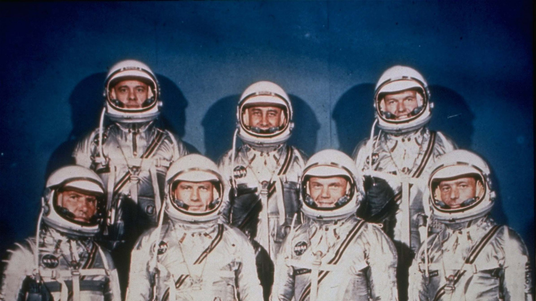 This 1961 file photo provided by NASA shows the original seven Mercury astronauts in their silver spacesuits. First row, from left are Walter Schirra Jr., Donald Slayton, John Glenn and Scott Carpenter. In the back row are Alan Shepard, Jr., Virgil Grissom and Gordon Cooper.