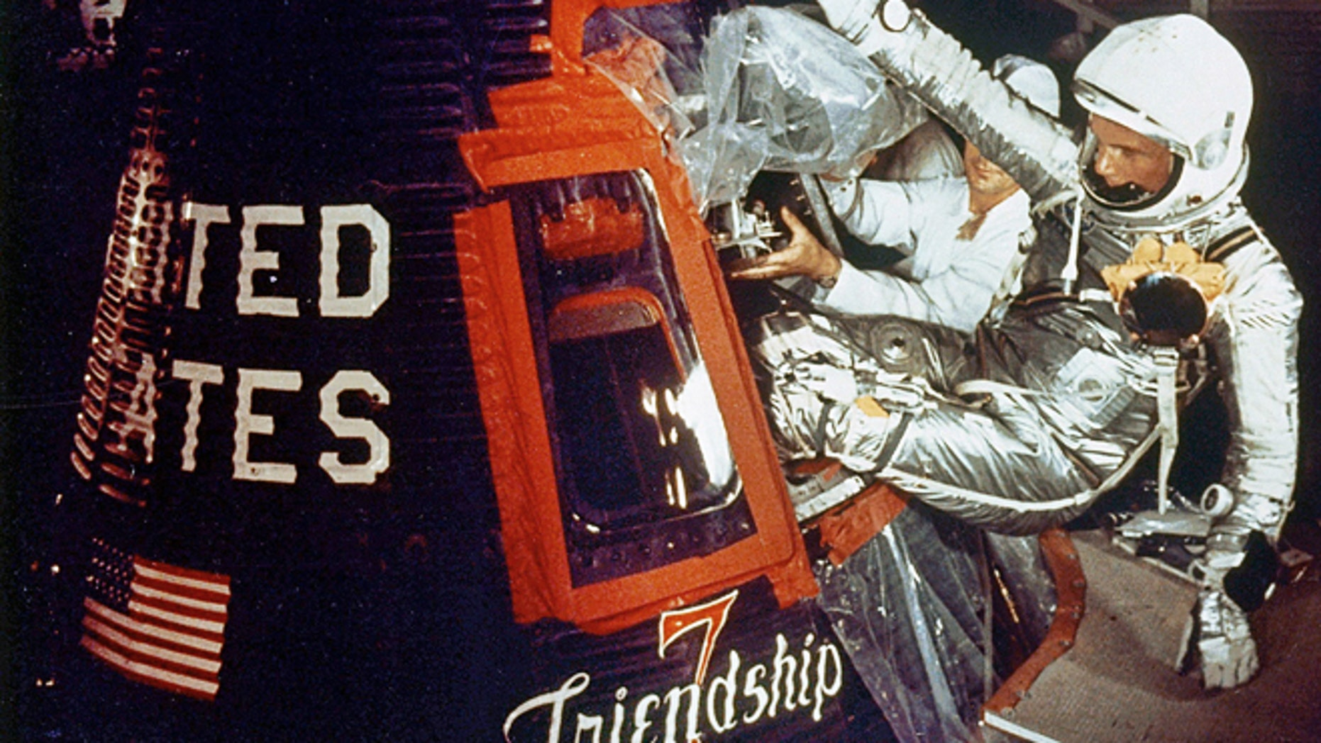 Feb. 20, 1962: Astronaut John Glenn climbs into the Friendship 7 space capsule atop an Atlas rocket at Cape Canaveral, Fla. for the flight which made him the first American to orbit the earth.