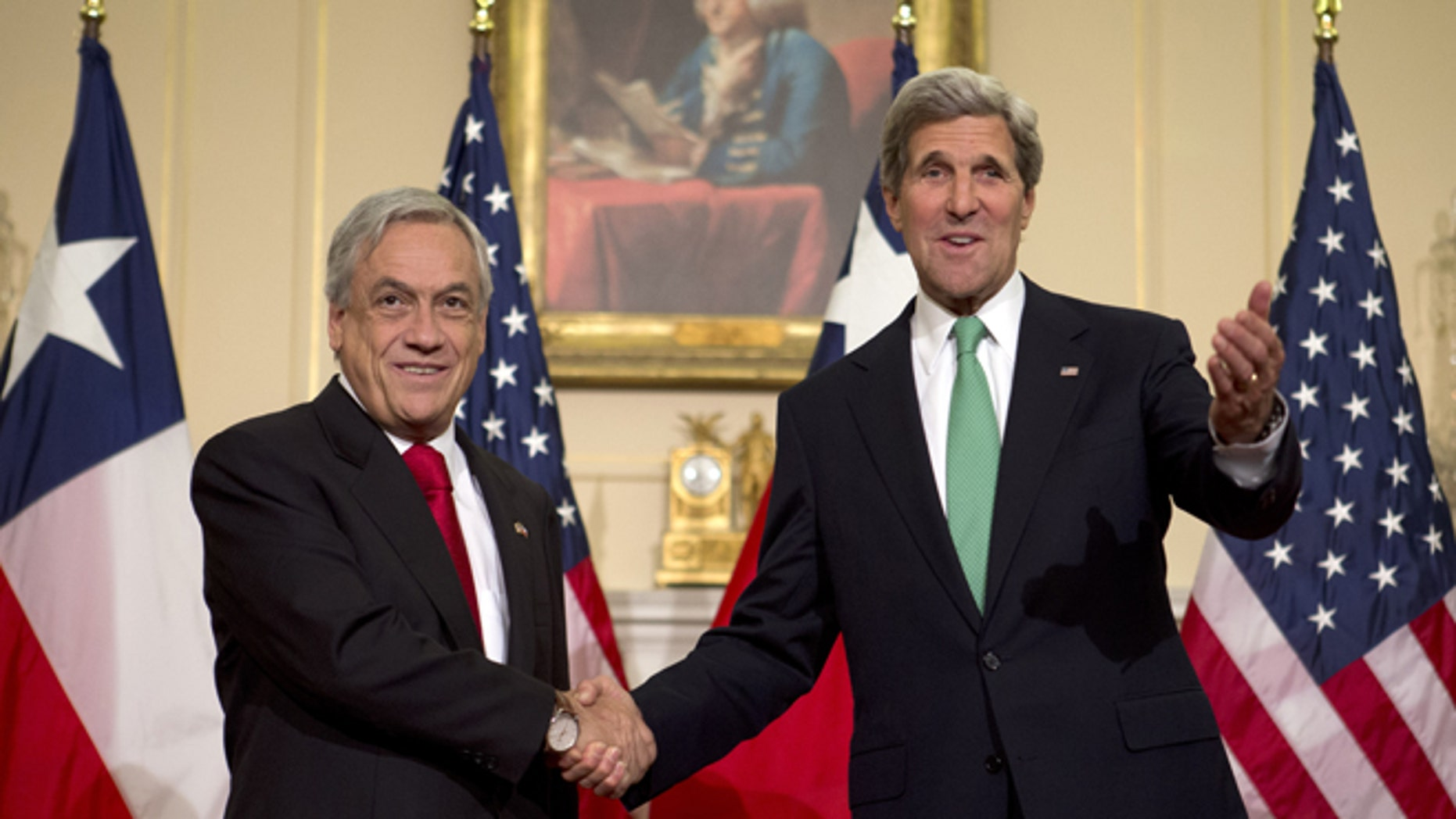 Secretary of State John Kerry gestures as he shakes hands with Chile's President Sebastian Pinera during a short appearance before the media, Monday, June 3, 2013, at the State Department in Washington. (AP Photo/Jacquelyn Martin)