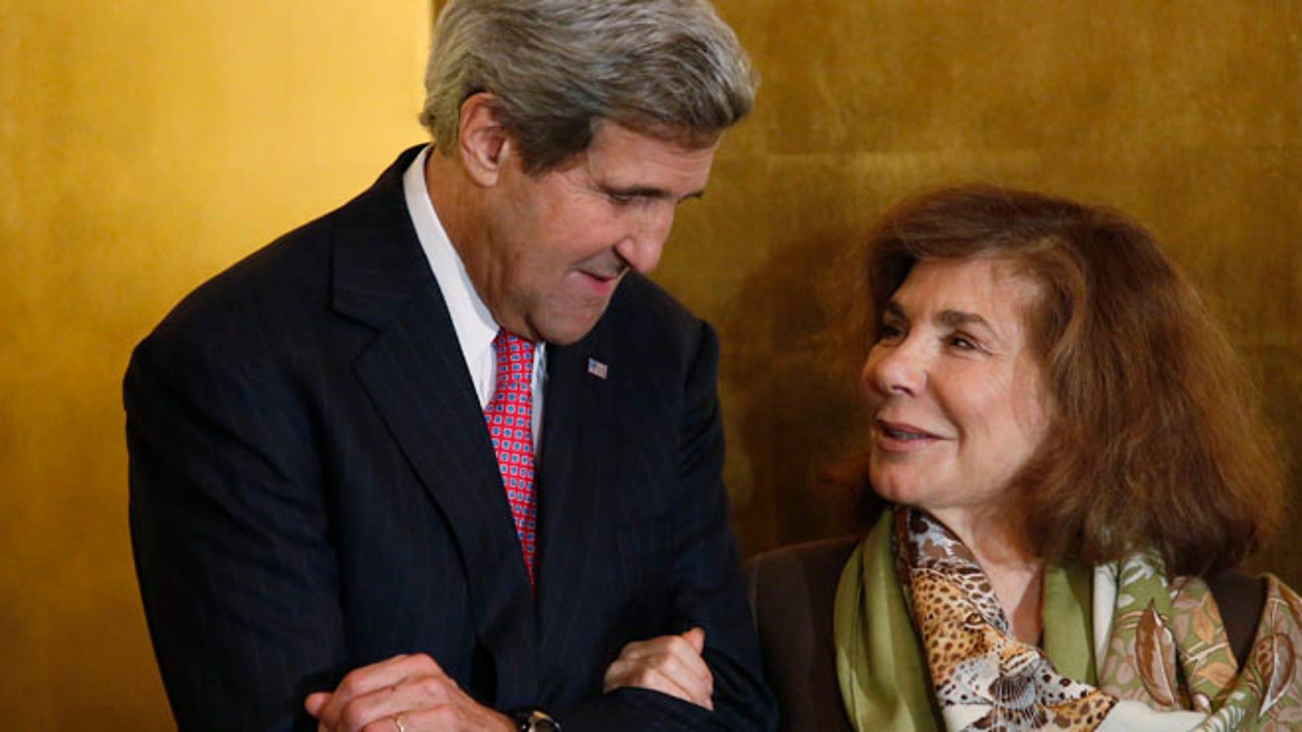 This November 12, 2013 photos shows U.S. Secretary of State John Kerry and his wife Teresa Heinz Kerry in Washington.