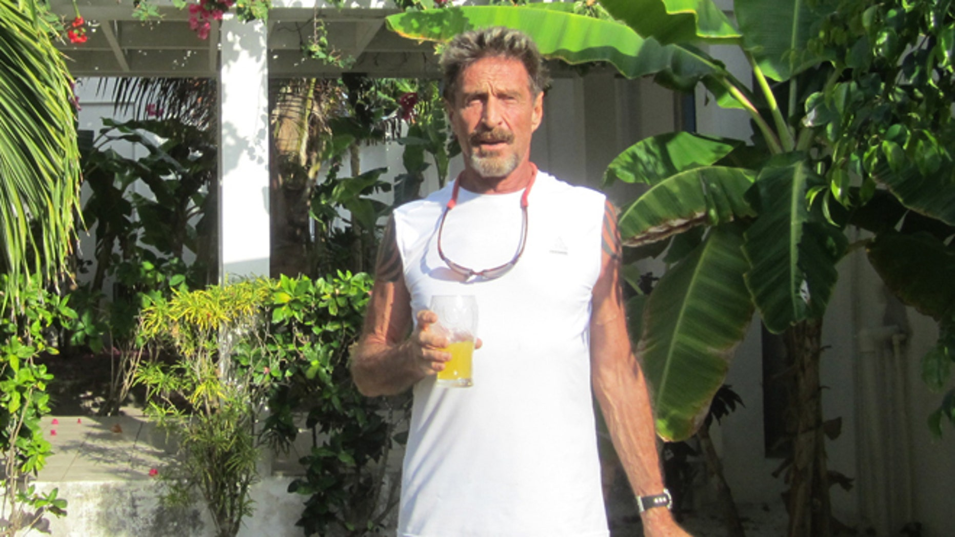 John McAfee, the founder of the antivirus company that still bears his name, seen in his hacienda in Belize.