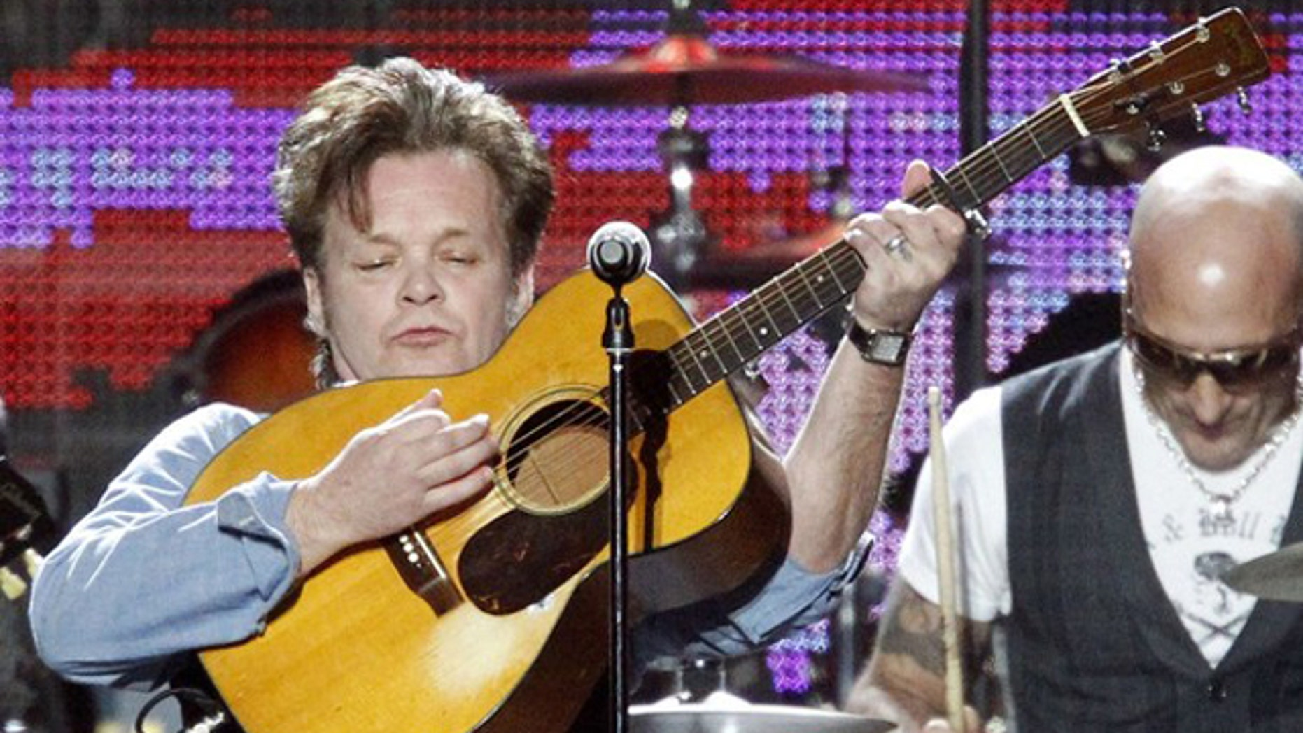 """Singer John Mellencamp performs """"Down By The River"""" at the 2010 MusiCares Person of the Year tribute honoring recording artist Neil Young in Los Angeles January 29, 2010."""