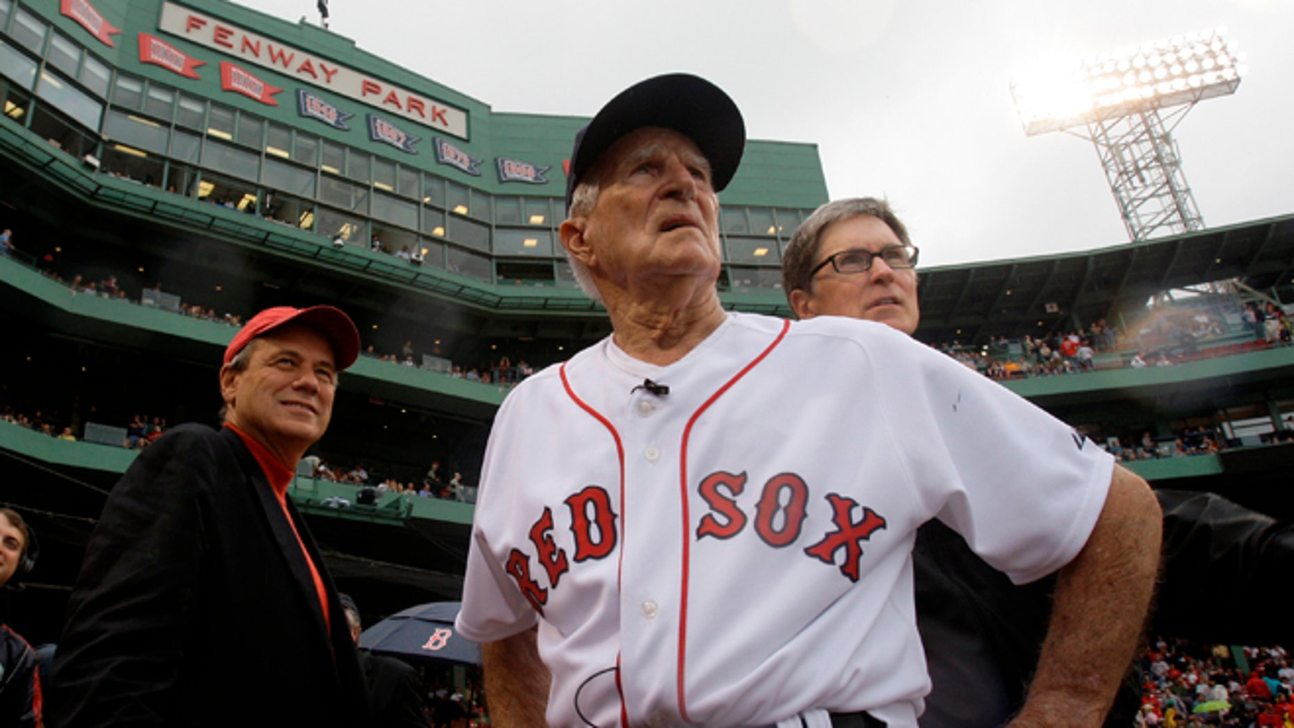 Sept. 28, 2008: Boston Red Sox great Johnny Pesky, center, is flanked by team president Larry Lucchino, left, and owner John Henry as they look past Pesky's Pole where Pesky's No. 6 adorns the upper deck during a ceremony to retire his number.