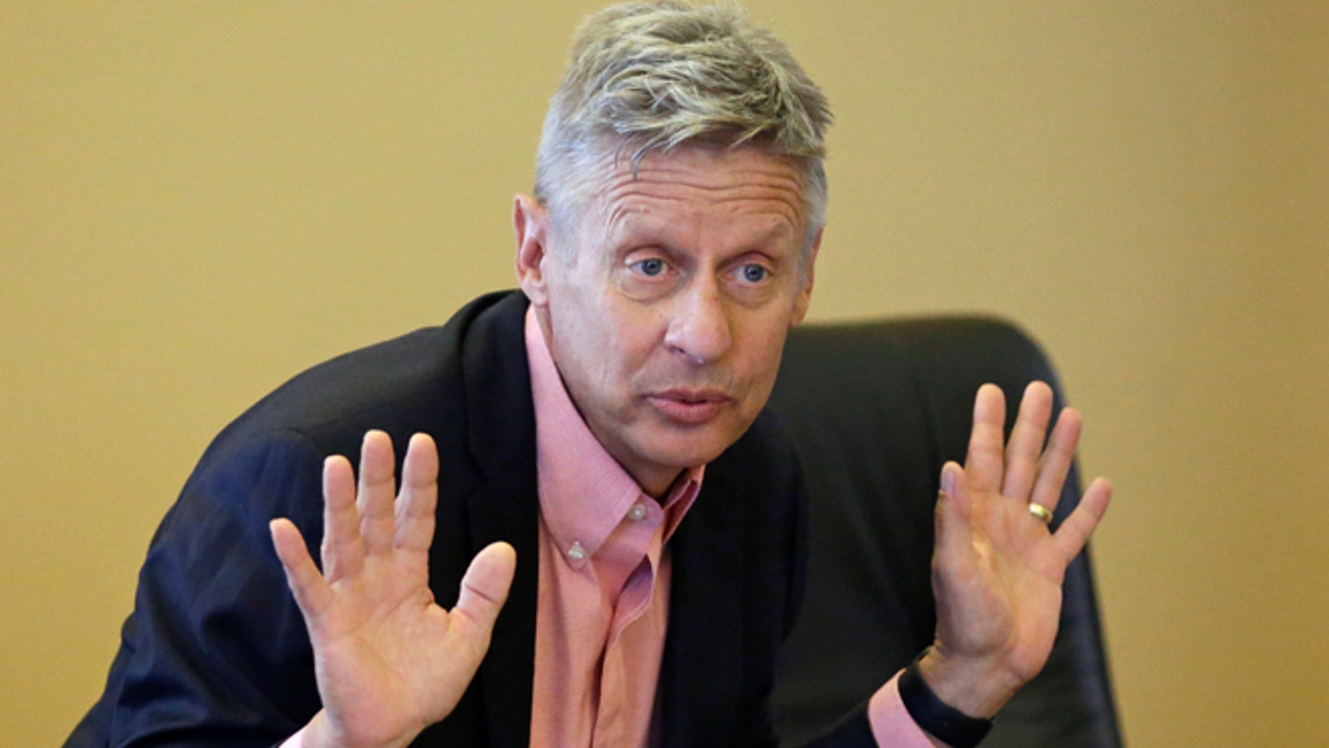 FILE - In this May 18, 2016 file photo, Libertarian presidential candidate, former New Mexico Gov. Gary Johnson speak with legislators at the Utah State Capitol in Salt Lake City. Utah Republicans, mostly Mormons, are now struggling to figure out how to cast their vote this November. Donald Trump has shattered the normal Republican consensus in Utah even more so than he has nationwide, activating fault lines under a normally stable electorate largely unified by a single religion. (AP Photo/Rick Bowmer, File)
