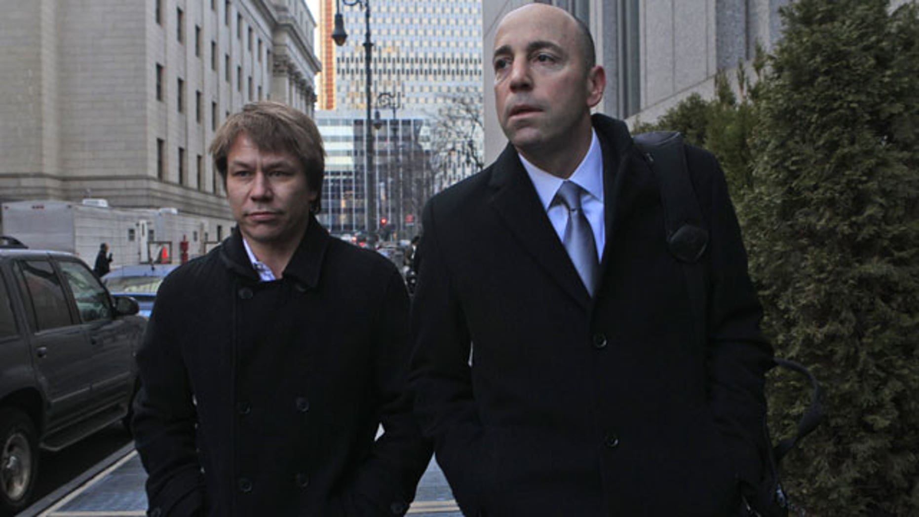 January, 18, 2012: Jon Horvath, left, an analyst at Sigma Capital Management leaves Manhattan Federal court in New York with his attorney. A hedge fund co-founder, four financial analysts and a Dell Inc. employee teamed up in a record-setting insider trading scheme that netted more than $61.8 million in illegal profits based on trades of a single stock, authorities said Wednesday.