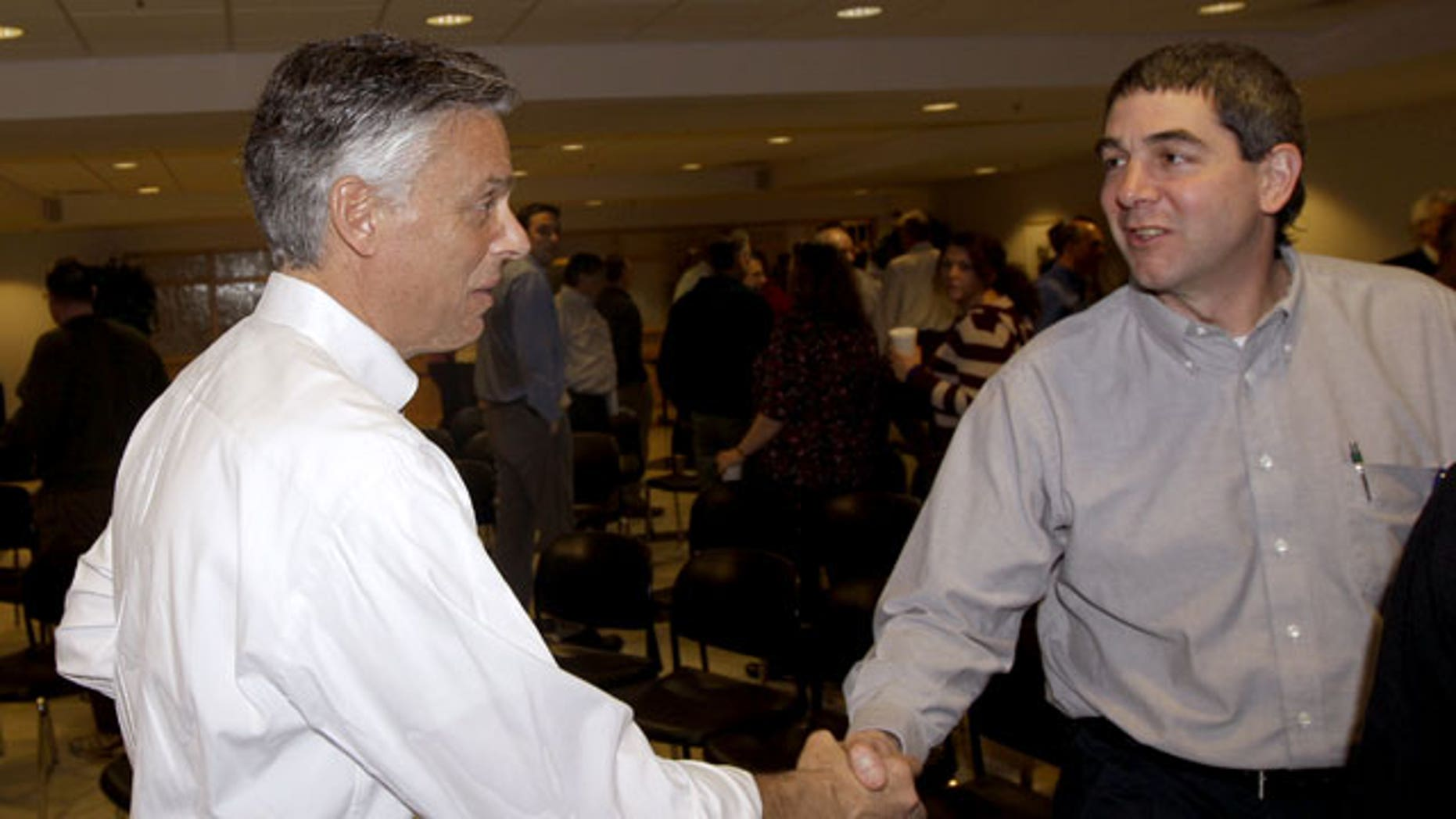 January 5, 2012: Republican presidential candidate, former Utah Gov. Jon Huntsman shakes the hand of an employee after a town hall style meeting at Goss International in Durham, N.H.
