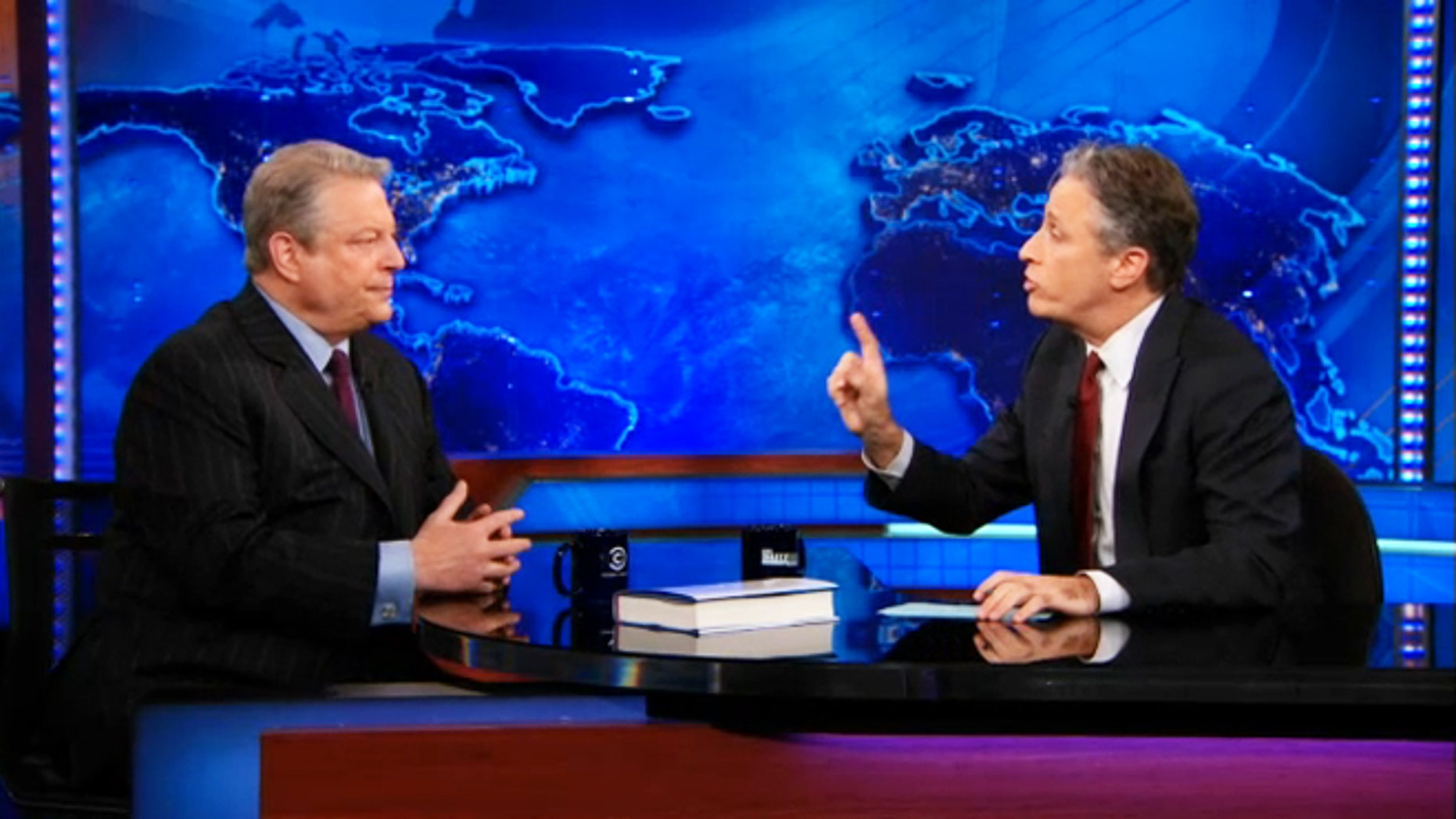 "Al Gore, left, sits down with Jon Stewart to discuss Current TV and Al Jazeera on ""The Daily Show."""