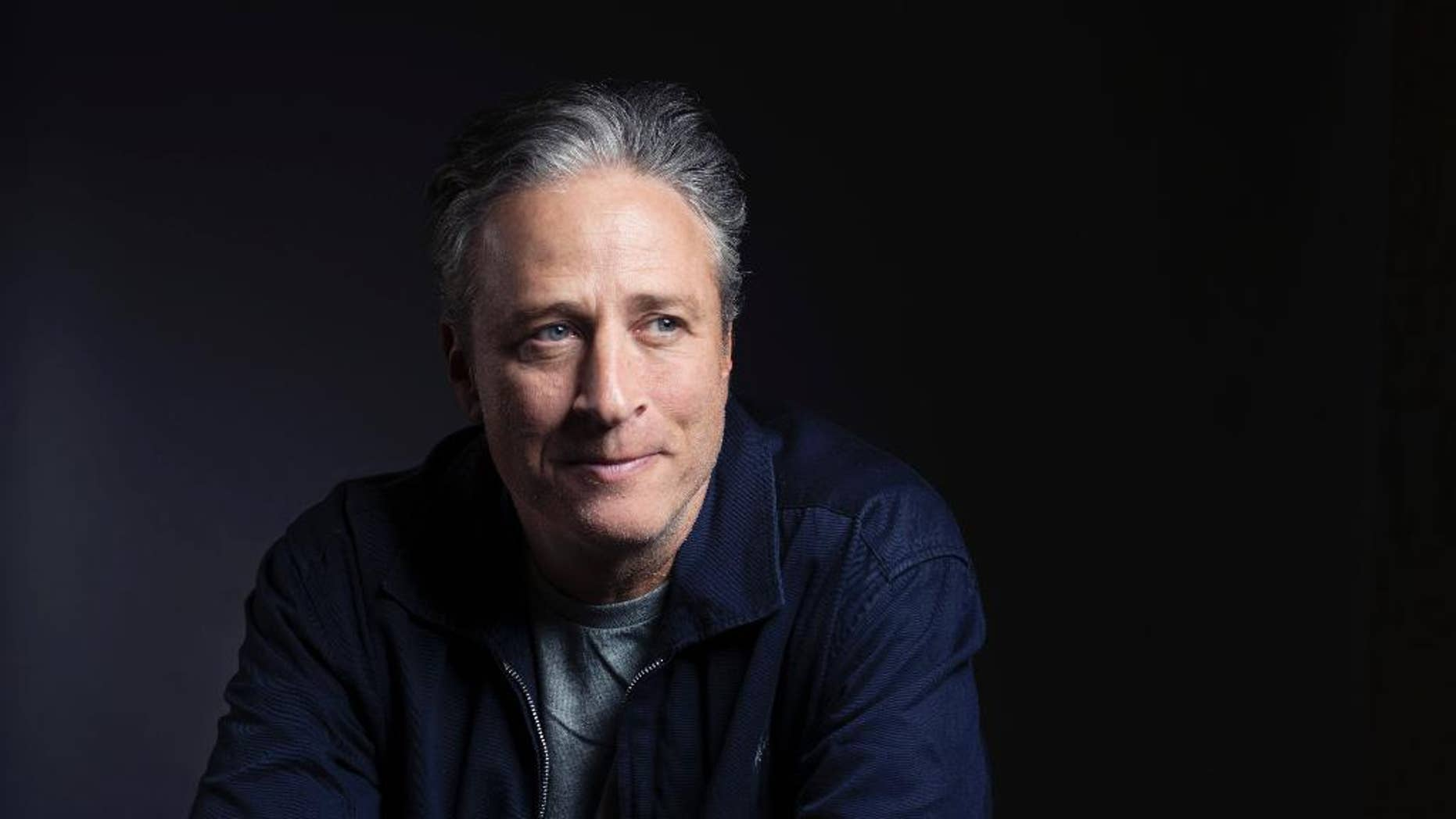 """In this Nov. 7, 2014 photo, Jon Stewart poses for a portrait in promotion of his film,""""Rosewater,"""" in New York."""