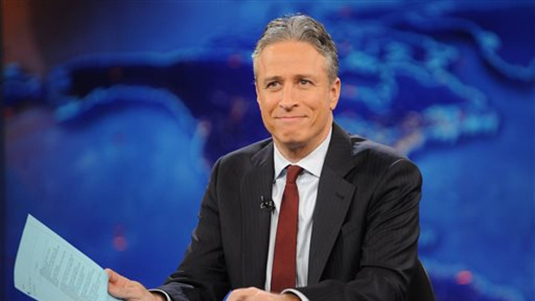 "FILE - This Nov. 30, 2011, file photo shows television host Jon Stewart during a taping of ""The Daily Show with Jon Stewart"" in New York. (AP Photo/Brad Barket, File)"