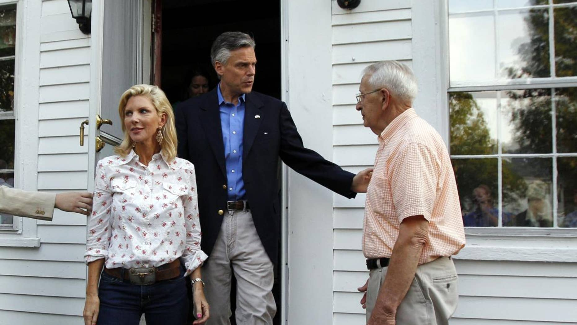 Likely 2012 presidential hopeful, former Republican Gov. Jon Huntsman, Jr., of Utah, and his wife, Mary Kaye, left, leave the home of Wally Stickney, right, after a gathering in Salem, N.H. Friday, June 10, 2011. (AP Photo/Elise Amendola)