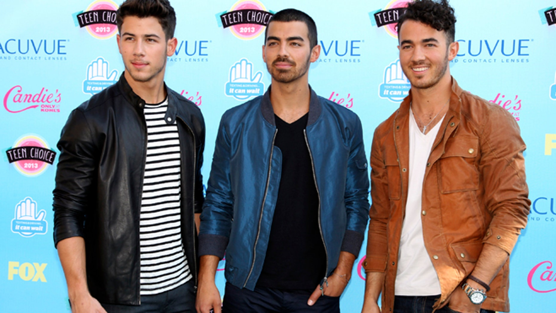Nick, Joe and Kevin Jonas pose as they arrive at the Teen Choice Awards at the Gibson amphitheatre in Universal City, California August 11, 2013.
