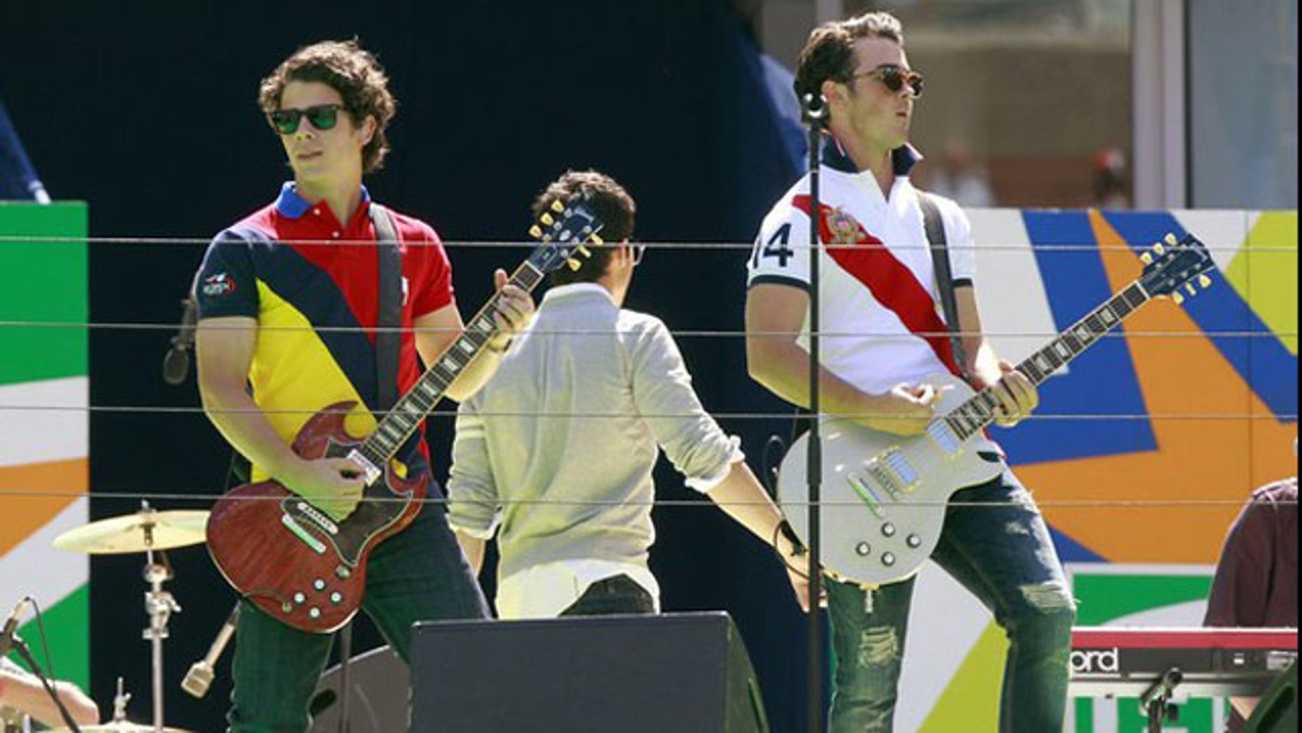 The Jonas Brothers perform. Their manager is launching a web search for the next big star.