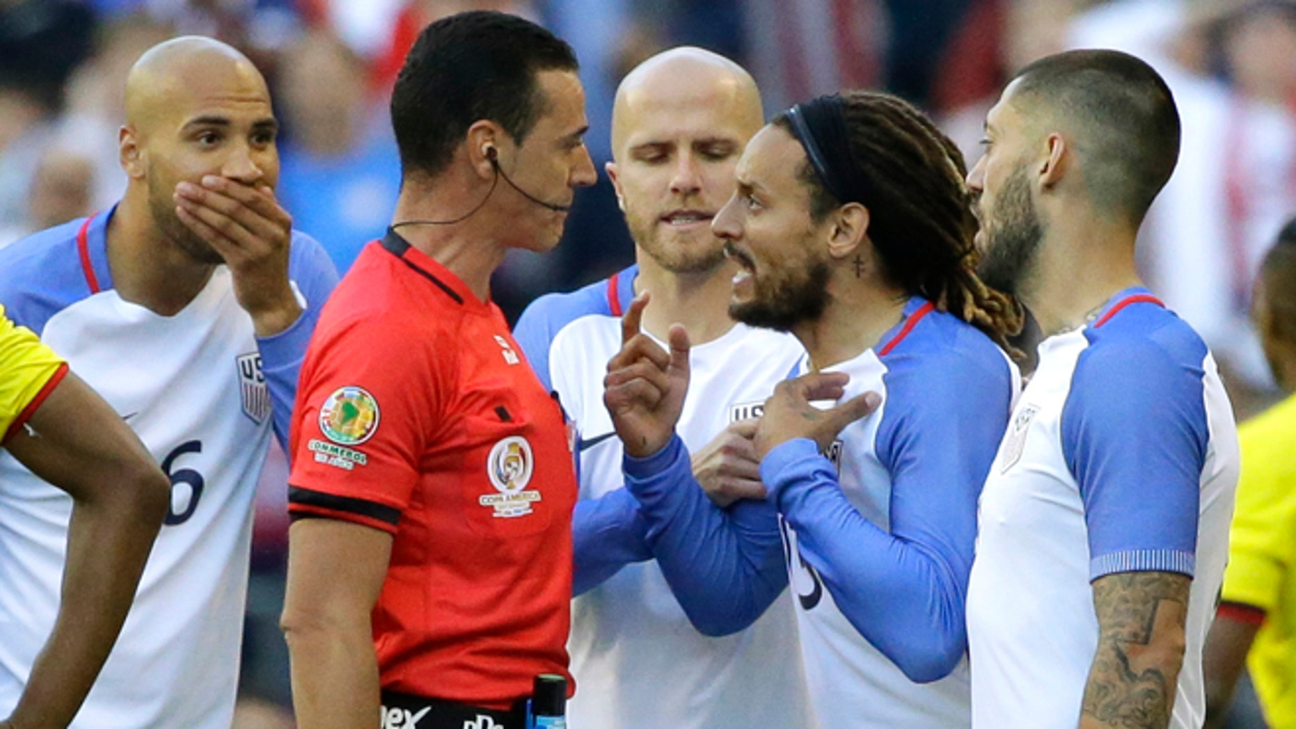 United States midfielder Jermaine Jones, second from right, protests to referee Wilmar Roldan, second from left, after Roldan gave Jones a red card in the second half of a Copa America Centenario soccer match against Ecuador, Thursday, June 16, 2016 at CenturyLink Field in Seattle. The United States beat Ecuador 2-1. (AP Photo/Ted S. Warren)