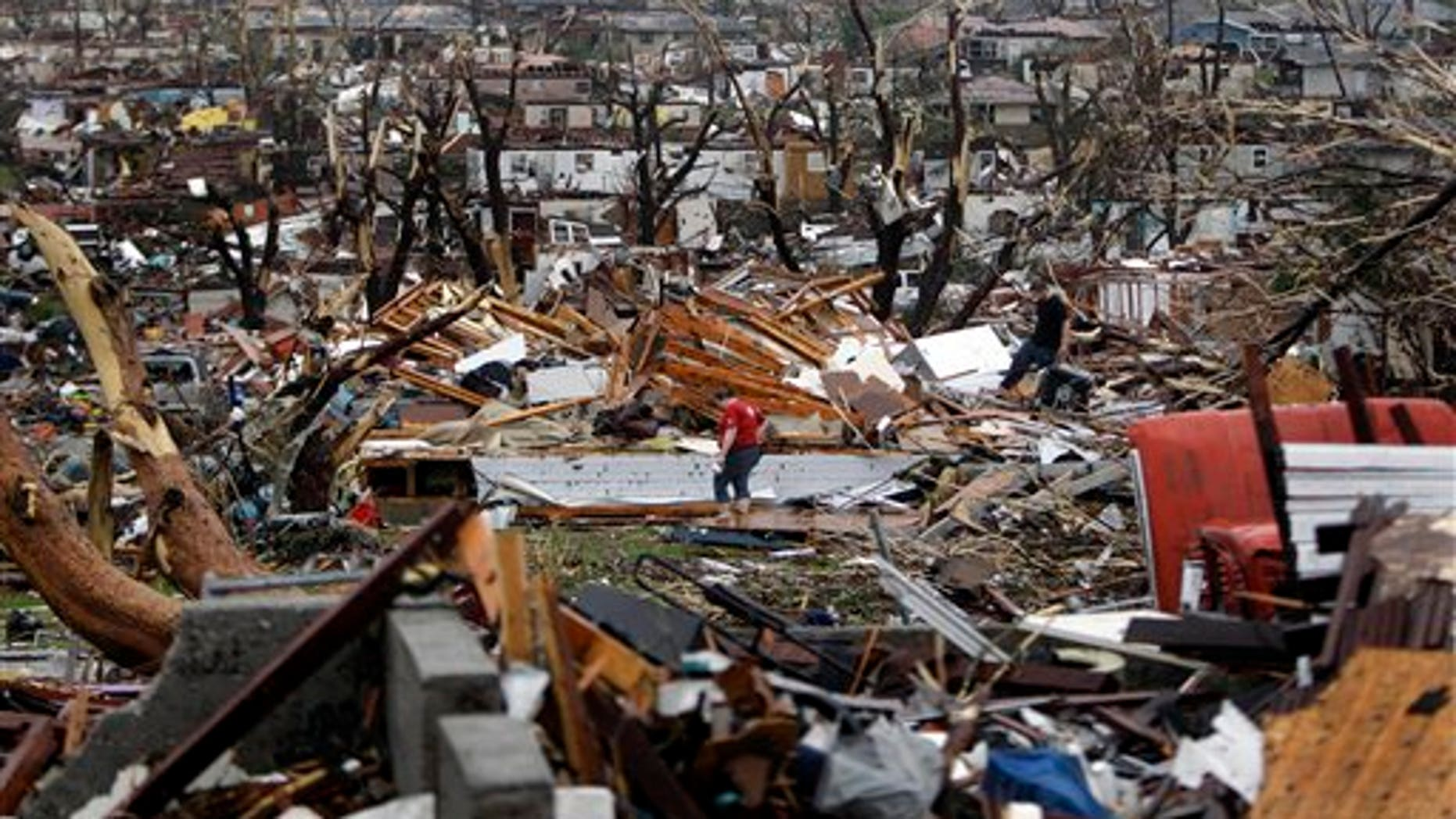 May 23: A large tornado moved through much of the city Sunday, damaging a hospital and hundreds of homes and businesses in Joplin , Mo.