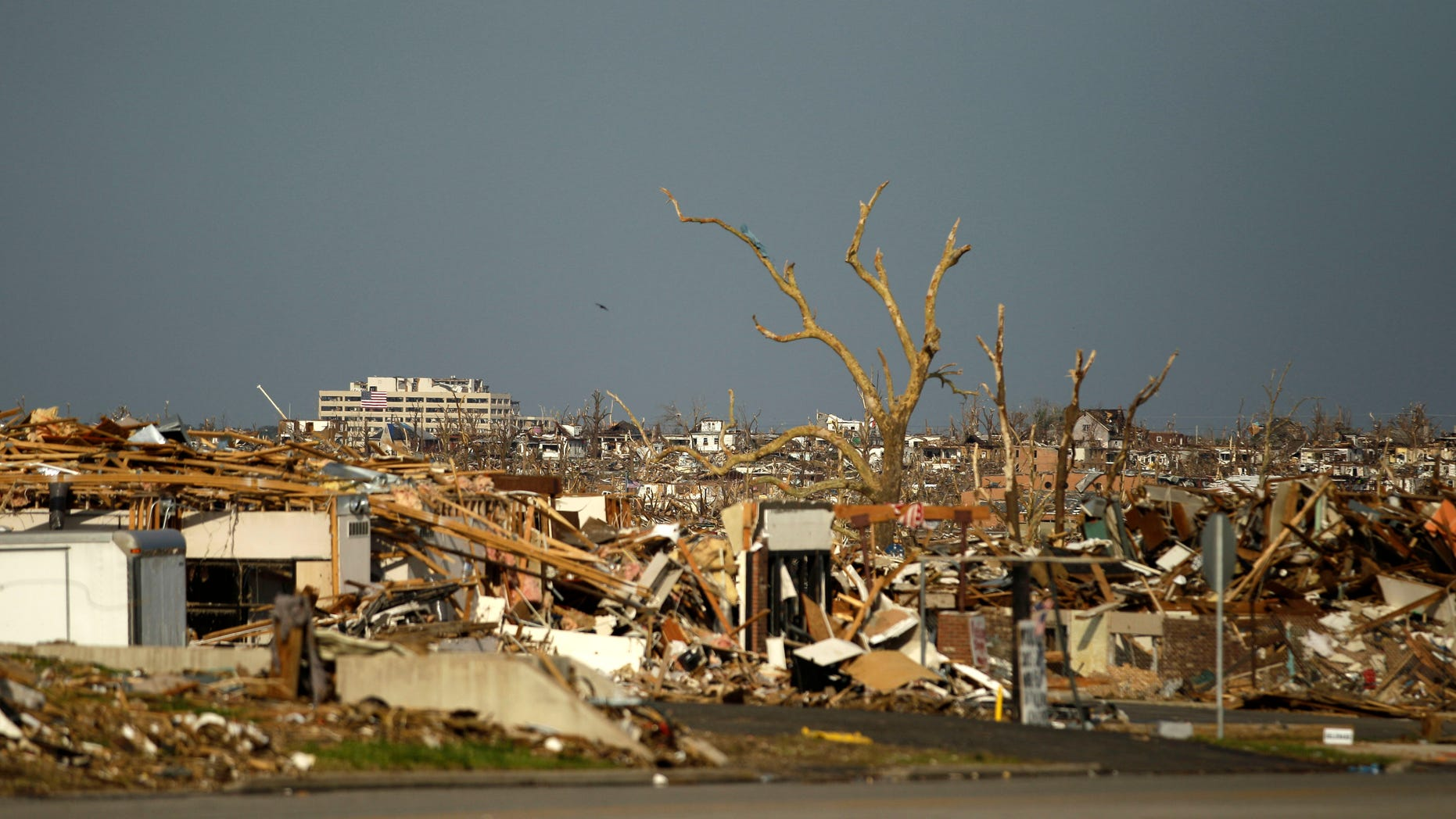 May 30: Damage is seen in a devastated Joplin, Missouri neighborhood. A federal agency was set to release a report today detailing communication efforts ahead of the massive twister that hit Joplin, killing more than 160 people.