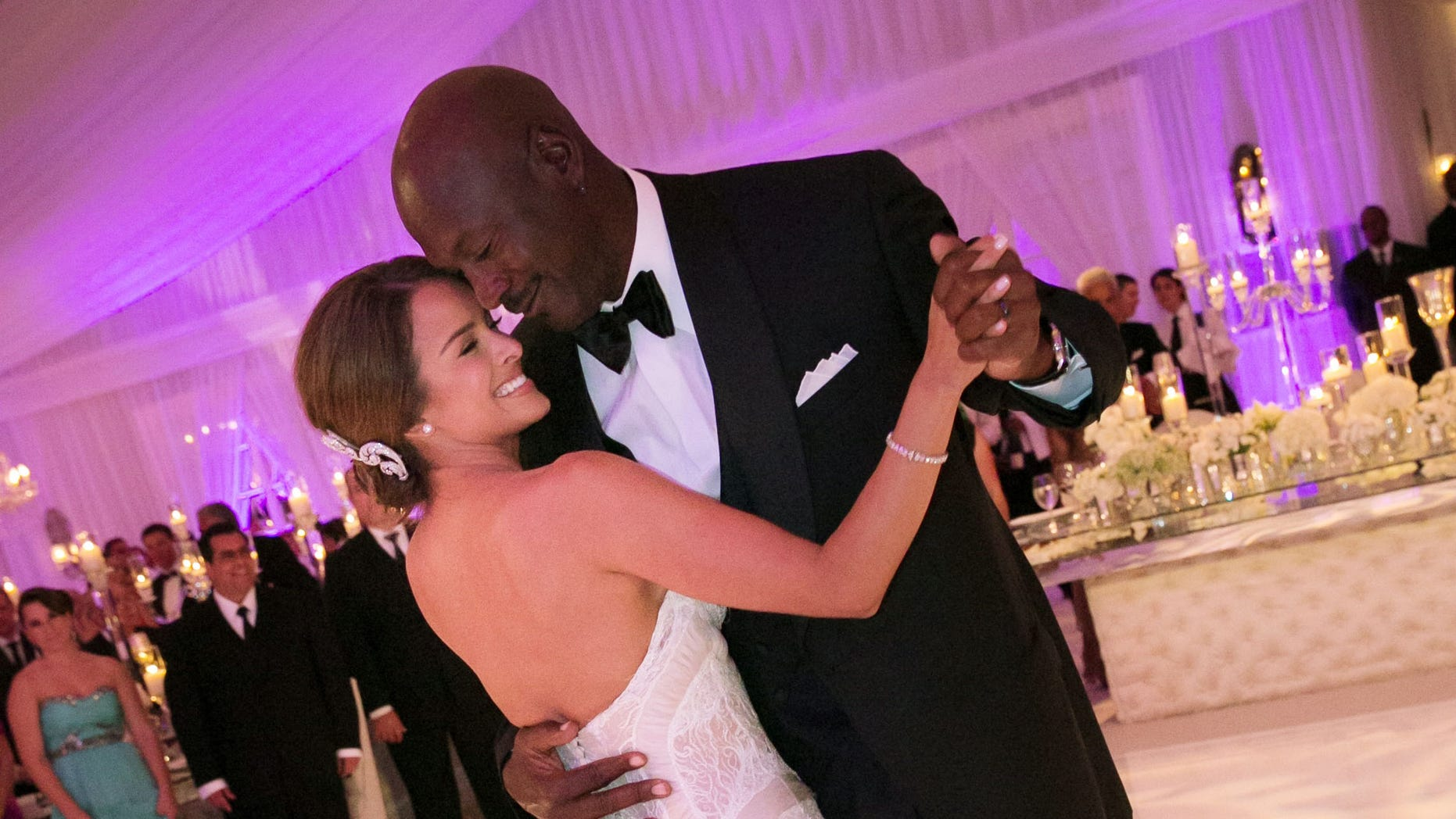 In this Saturday, April 27, 2013, photo provided by JUMP.DC, Charlotte Bobcats owner Michael Jordan dances with his bride Yvette Prieto during their wedding reception at the Bear's Club in Jupiter, Fla. The wedding took place at the Episcopal Church of Bethesda-by-the-Sea with more than 300 guests in attendance, including Tiger Woods, Patrick Ewing and Ahmad Rashad, Jordan's manager Estee Portnoy told The Associated Press Sunday.
