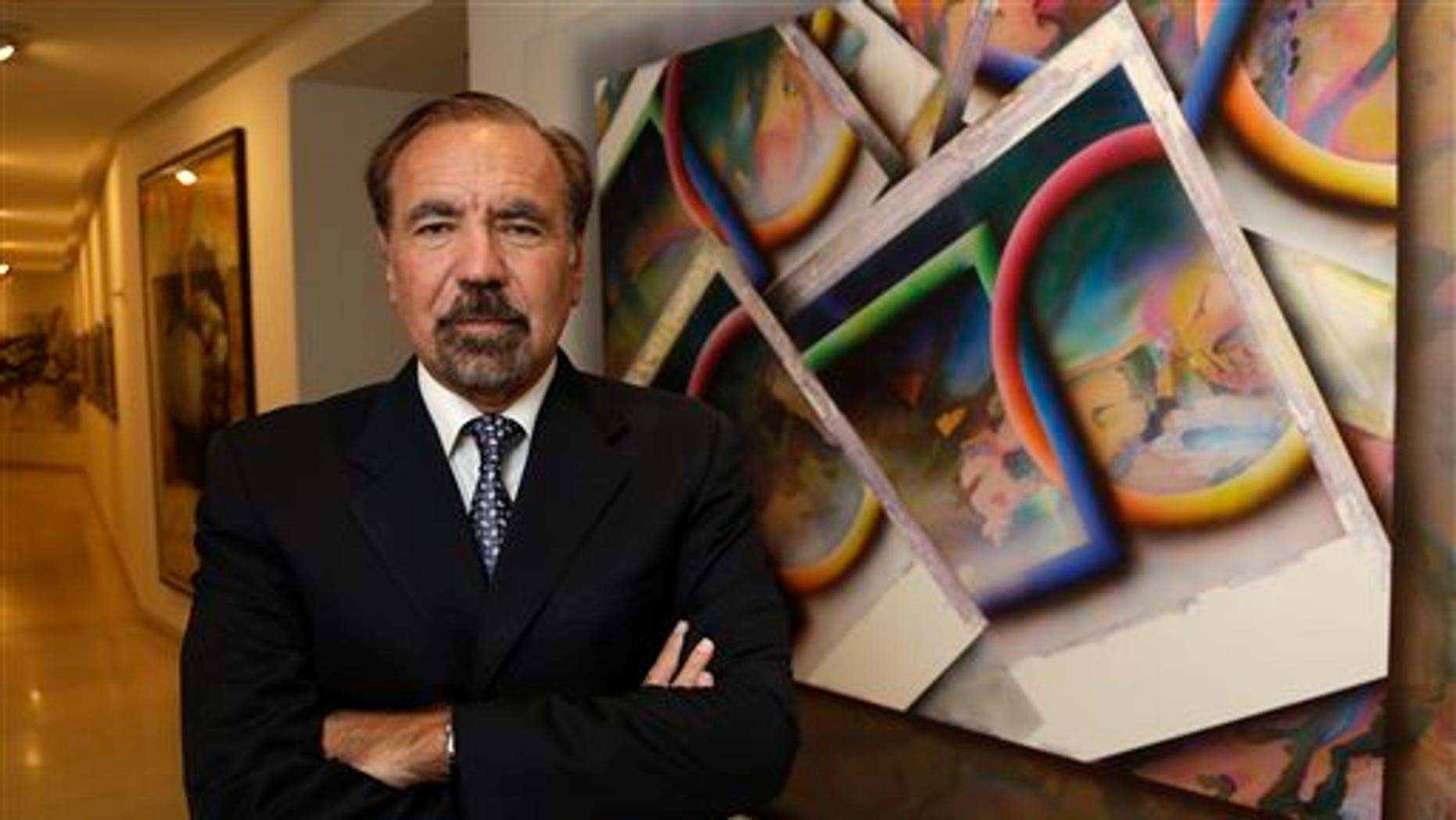 FILE- In this In this Dec. 11, 2013 file photo, developer and art collector Jorge Perez, poses for a photograph in his office at the Related Group, in Miami. Perez is one of Floridas powerful Cuban-American business leaders. He wants to soften the U.S. governments longtime economic embargo against Cubas communist government. (AP Photo/Lynne Sladky, File)