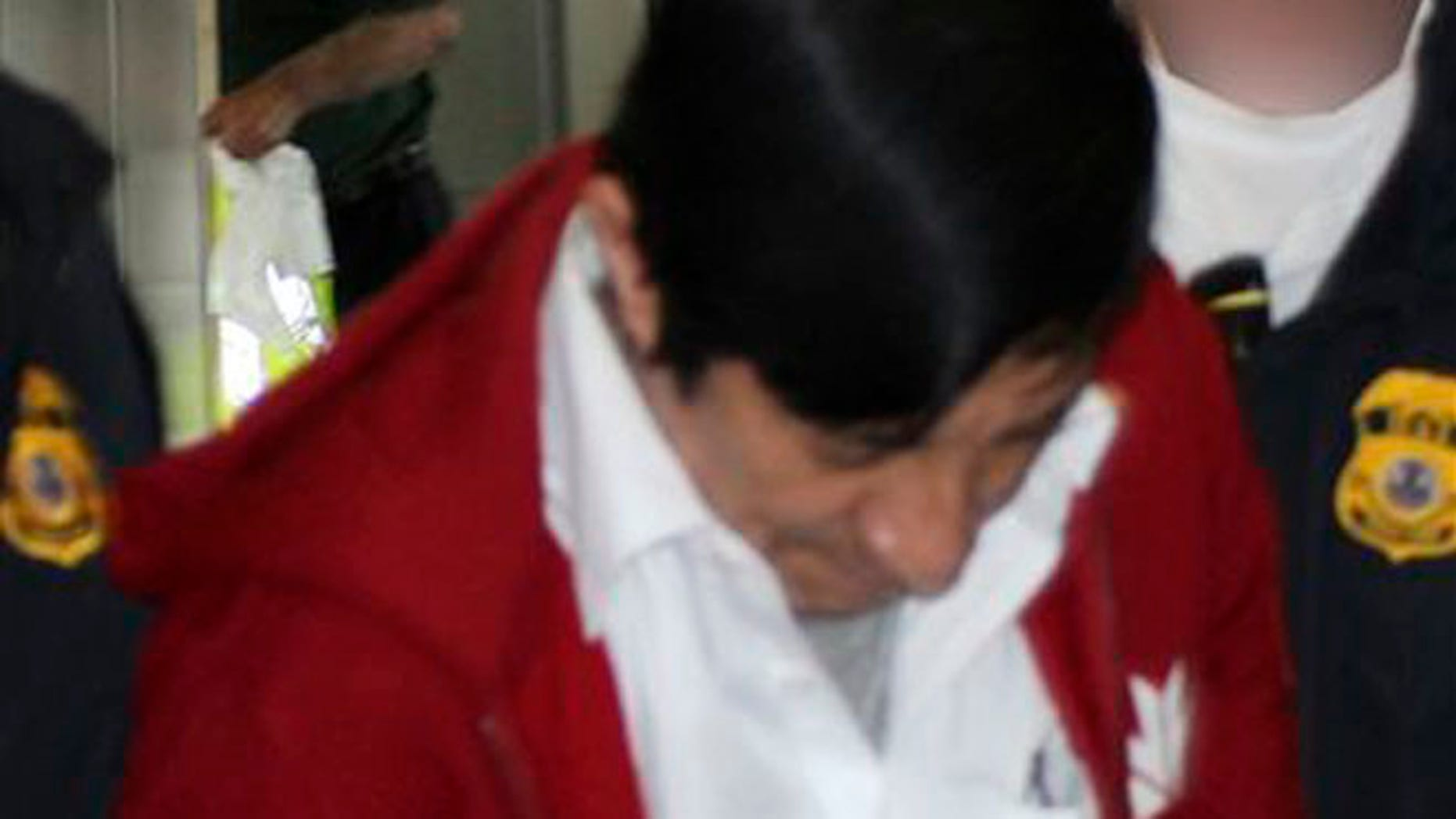 Jorge Sosa, a former Guatemalan soldier, as he is extradited to the U.S. from Canada on Sept. 21, 2012.