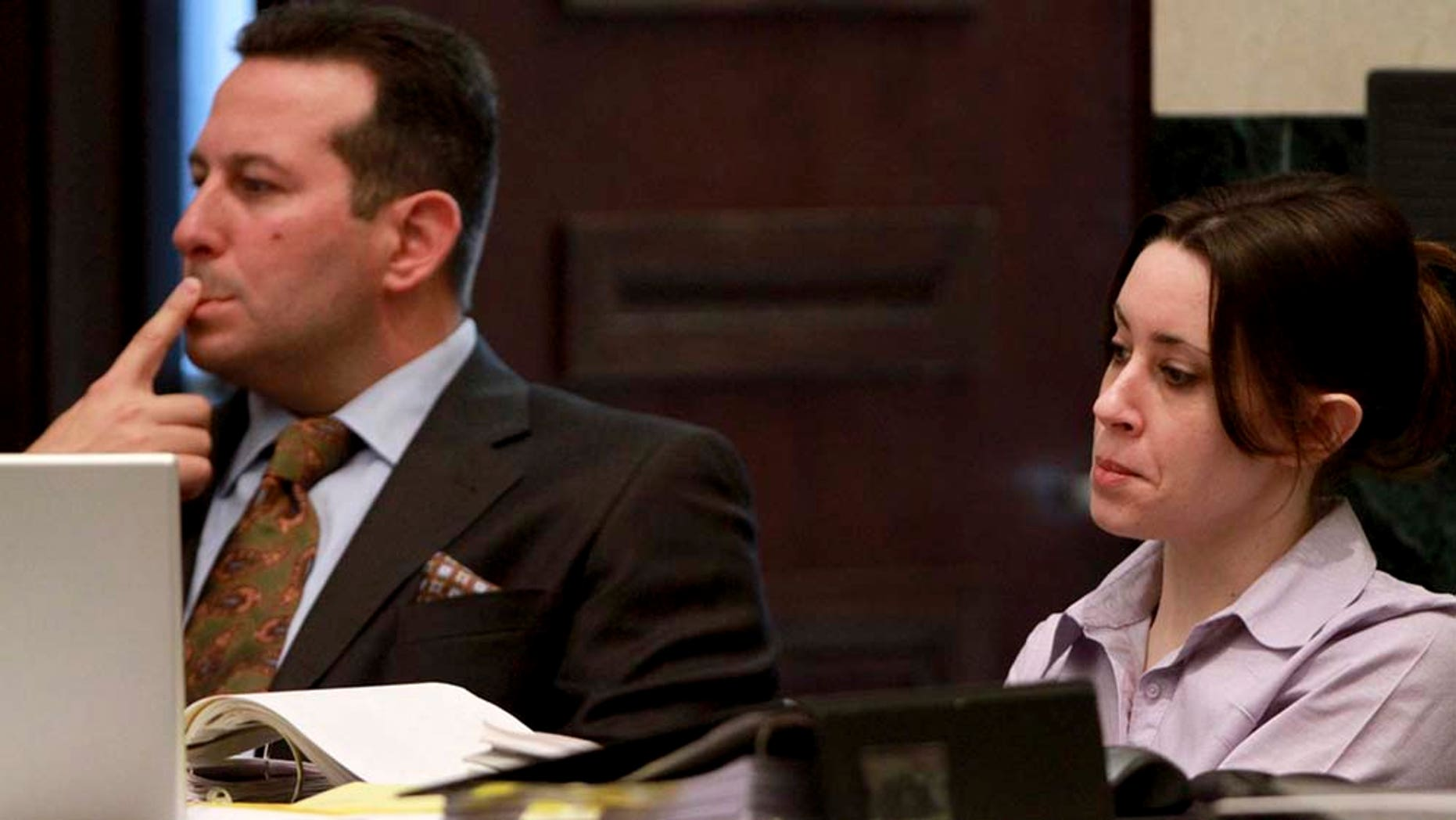 Casey Anthony, left, and her defense attorney, José Báez.