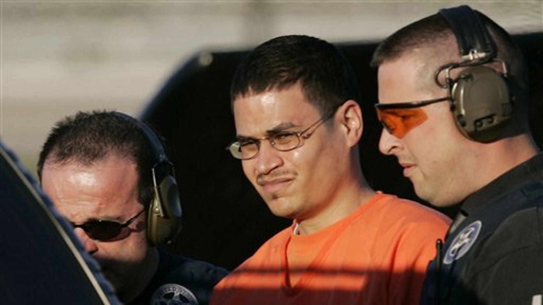 January 5, 2006: Jose Padilla is escorted to a waiting police vehicle by federal marshals near downtown Miami, FL.