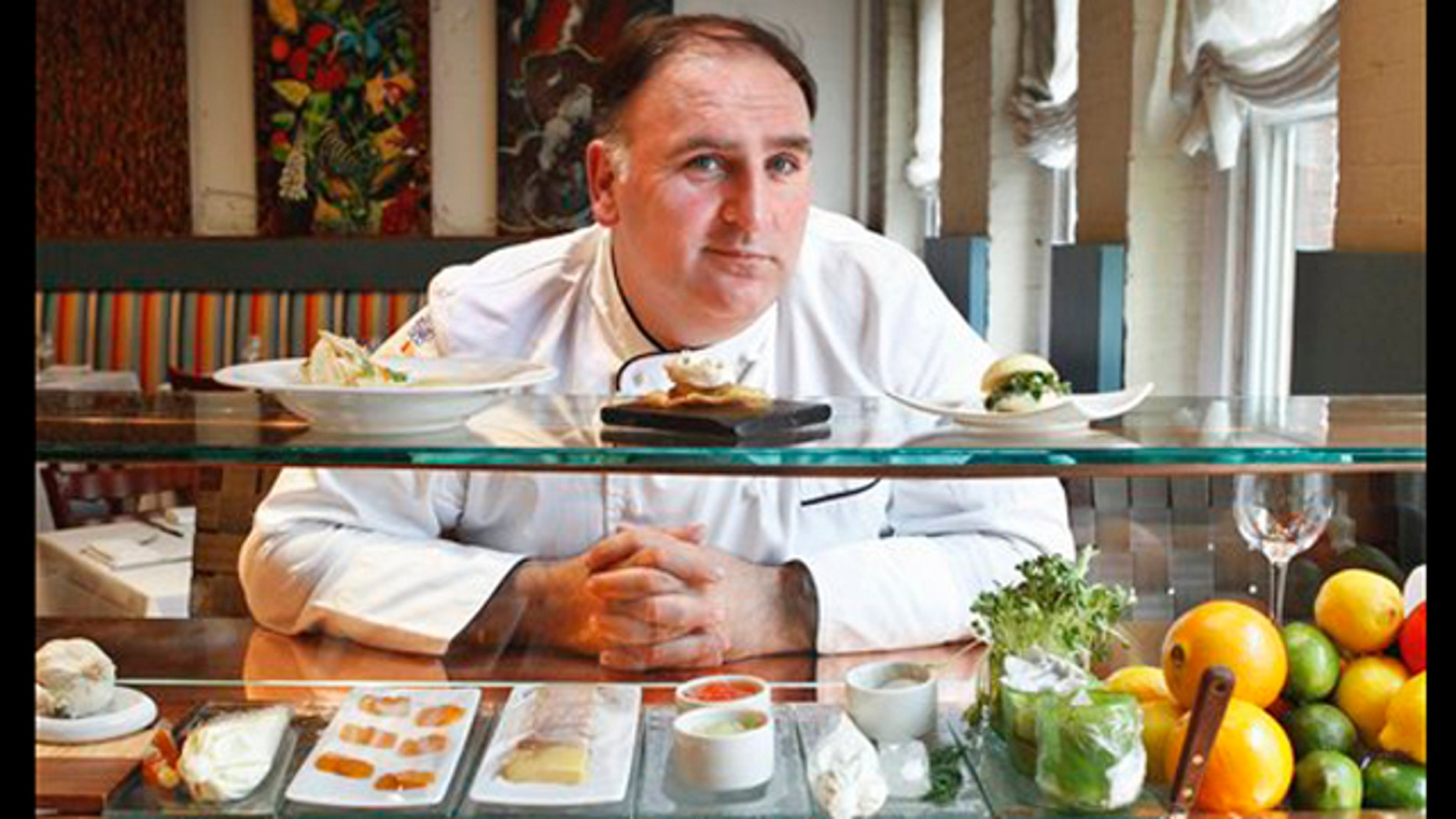 FILE-   This Tuesday, March 15, 2011 file photo shows chef Jose Andres at his Minibar restaurant in Washington. Small plates have earned Jose Andres one of the food world's biggest honors. The man credited with popularizing tapas _ the Spanish custom of dining on small, shared plates _ was named the nation's most outstanding chef Monday during the James Beard Foundation's annual awards ceremony, the so-called Oscars of the culinary crowd.  (AP Photo/Jacquelyn Martin, FILE)