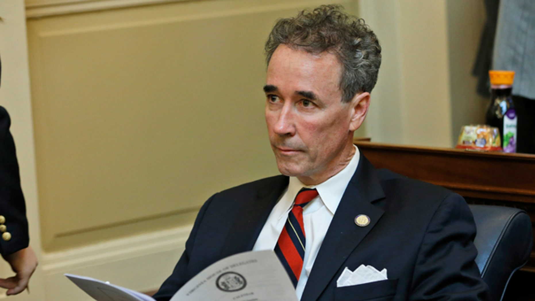 Del. Joe Morrissey, I-Henrico, looks over the calendar during the House session at the Capitol in Richmond, Va., Wednesday, Jan. 21, 2015.