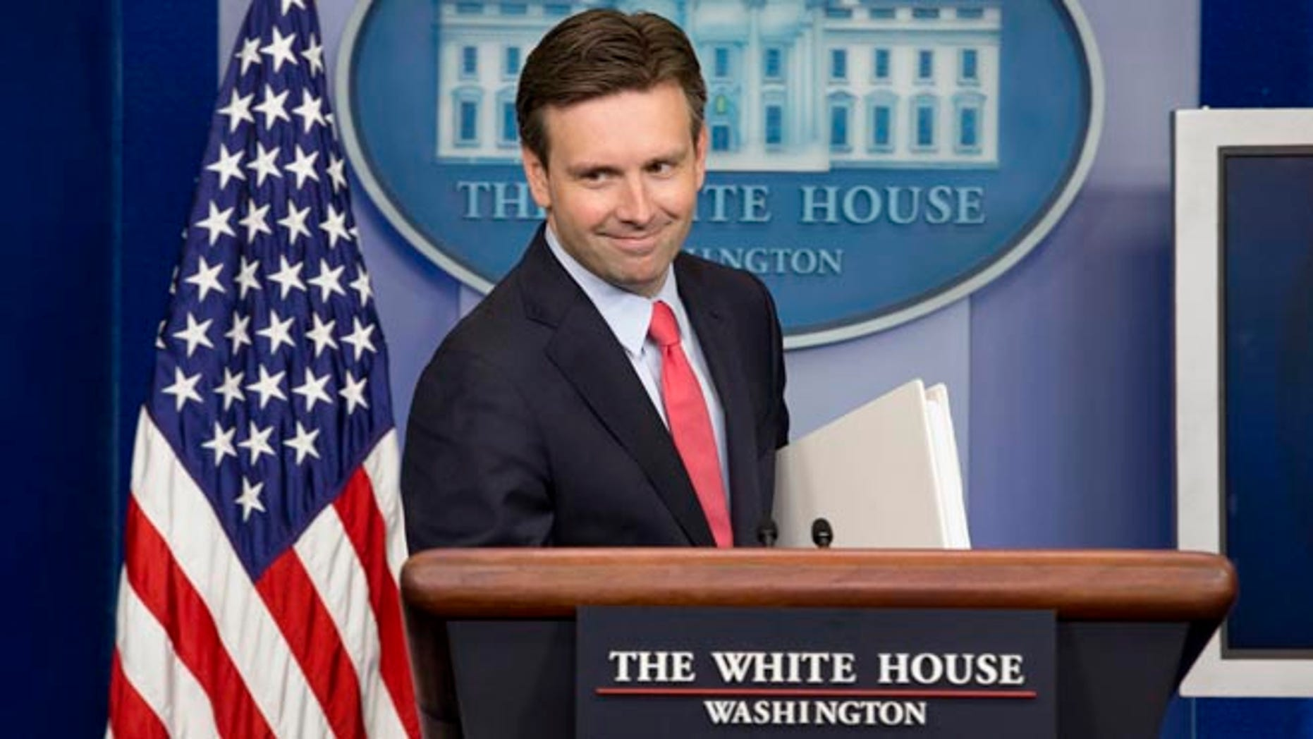 White House press secretary Josh Earnest, Monday, June 30, 2014, during the daily briefing in the Brady Press Briefing Room of the White House in Washington.