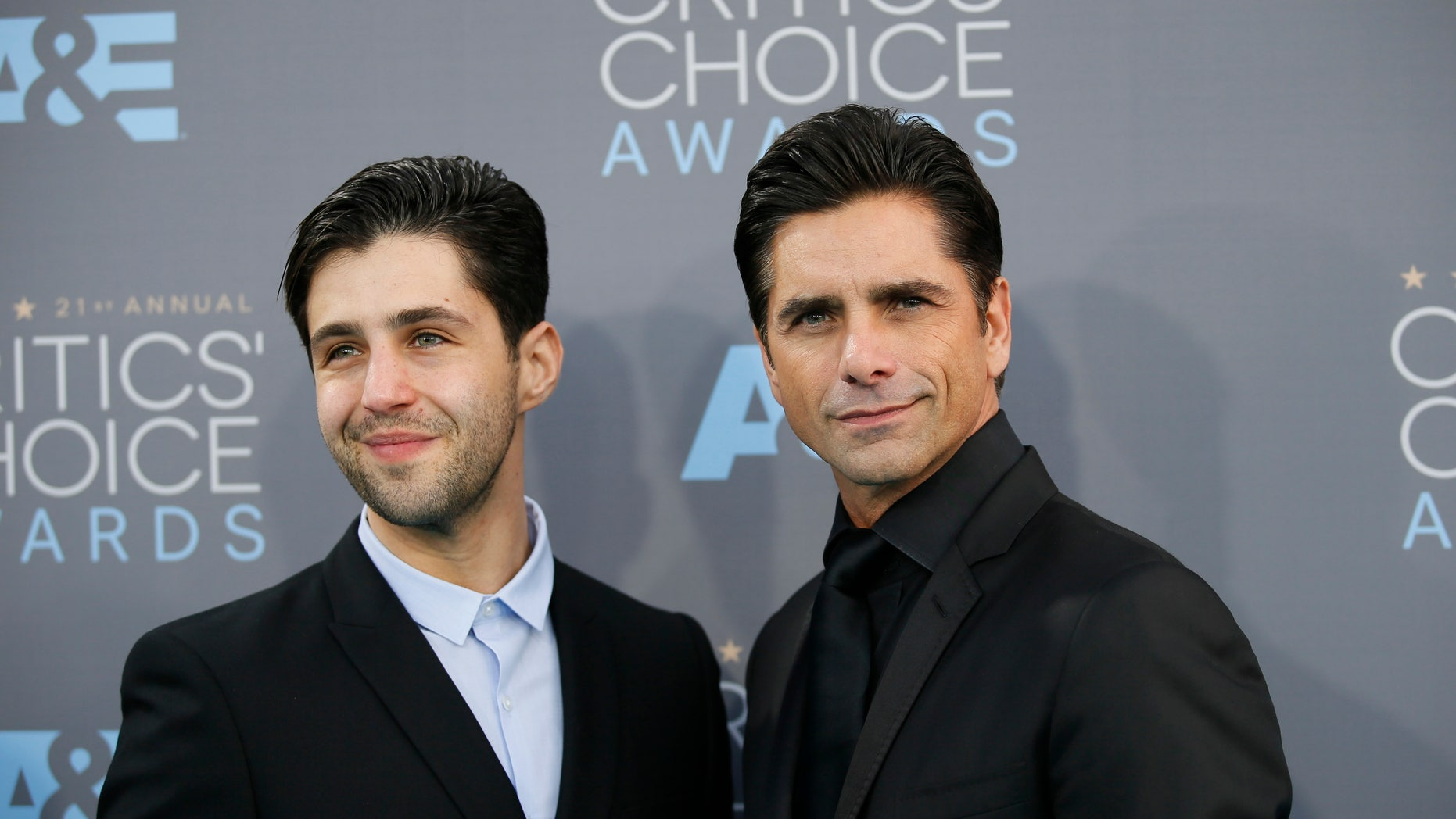 Actors Josh Peck, left, and John Stamos arrive at the 21st Annual Critics Choice Awards in Santa Monica, California January 17, 2016.  REUTERS/Danny Moloshok -