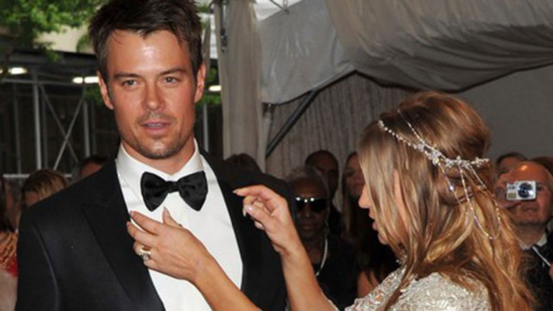 Josh Duhamel (shown here with wife Fergie) urged his fans via twitter to raise awareness of his flooded hometown of Minot, North Dakota.